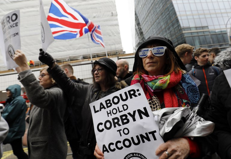 Demonstrators gather outside the head office of the UK Labour Party in London on 8 April 2018 (AFP)