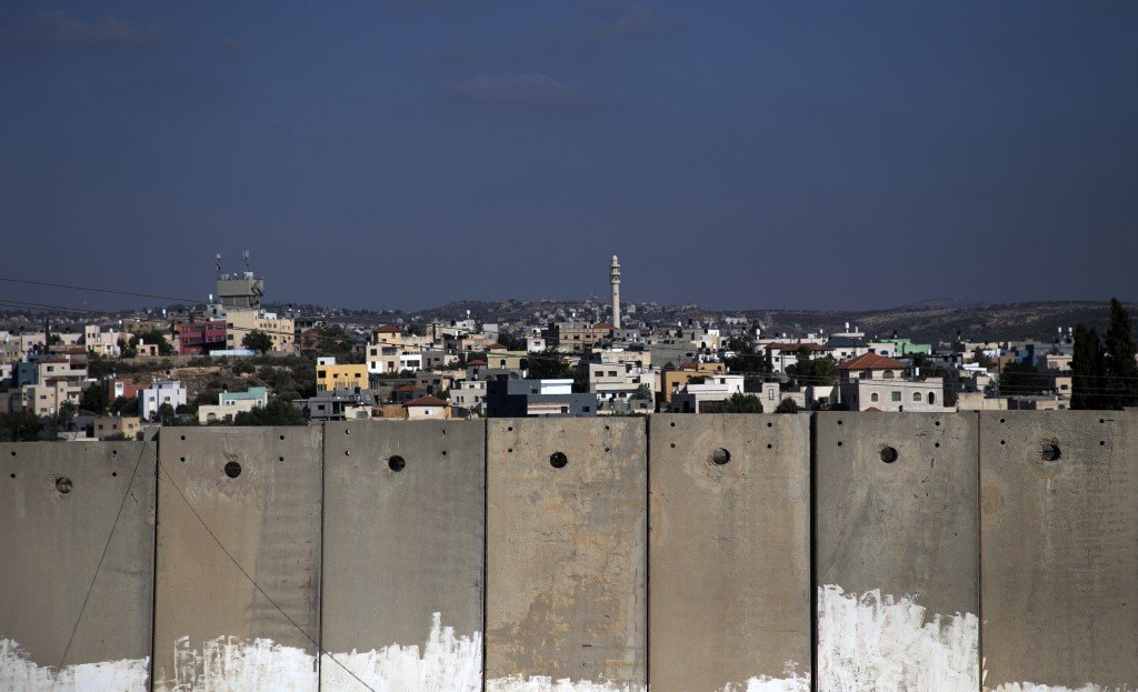 Israel's separation wall is pictured on 22 September (AFP)