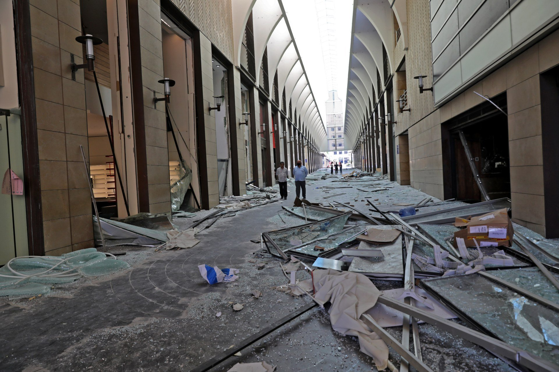 Lebanese in Beirut Souks shopping mall inspect the damage in the aftermath of yesterday's blast (AFP)