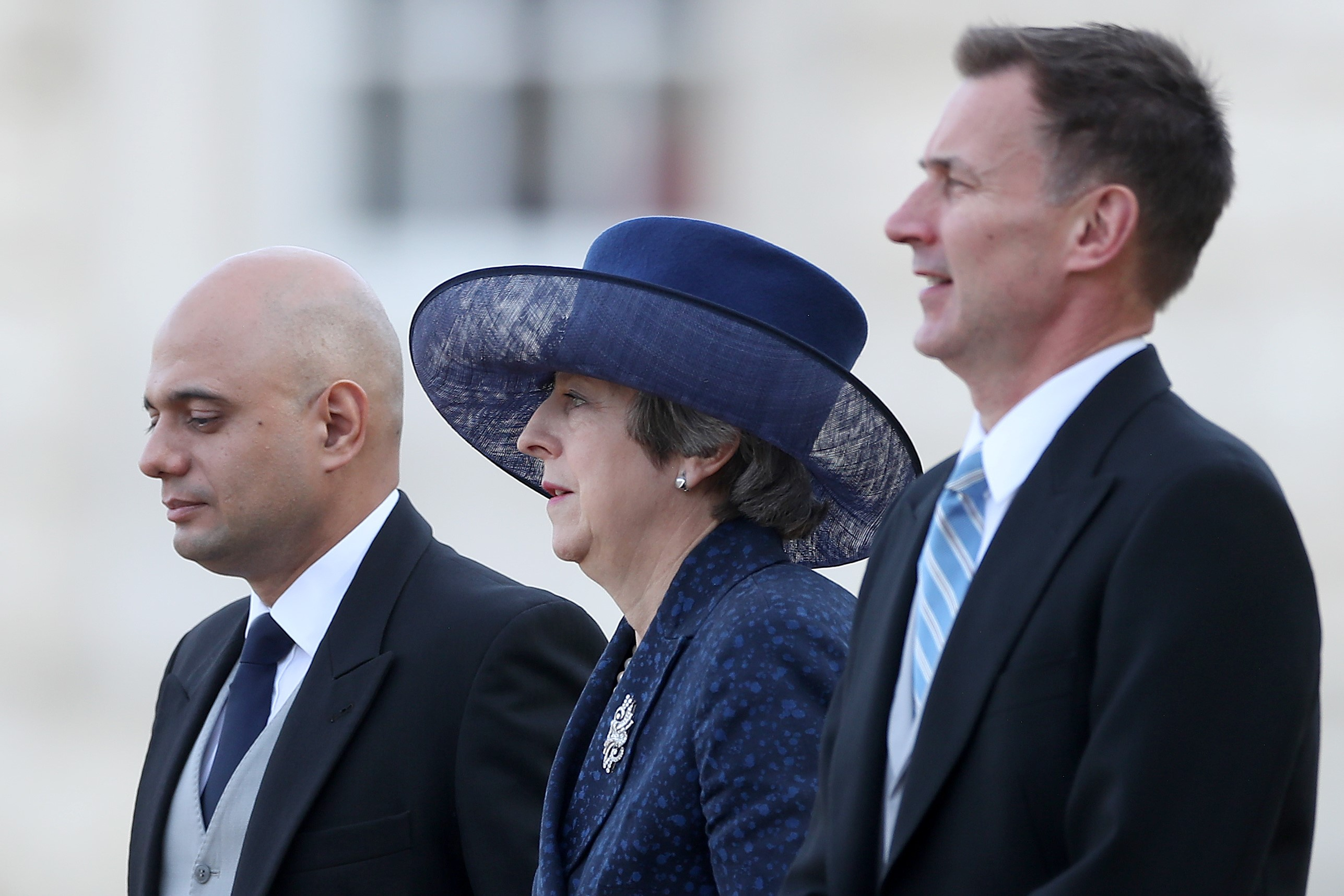 (L-R) Britain's Home Secretary Sajid Javid, Britain's Prime Minister Theresa May and Britain's Foreign Secretary Jeremy Hunt