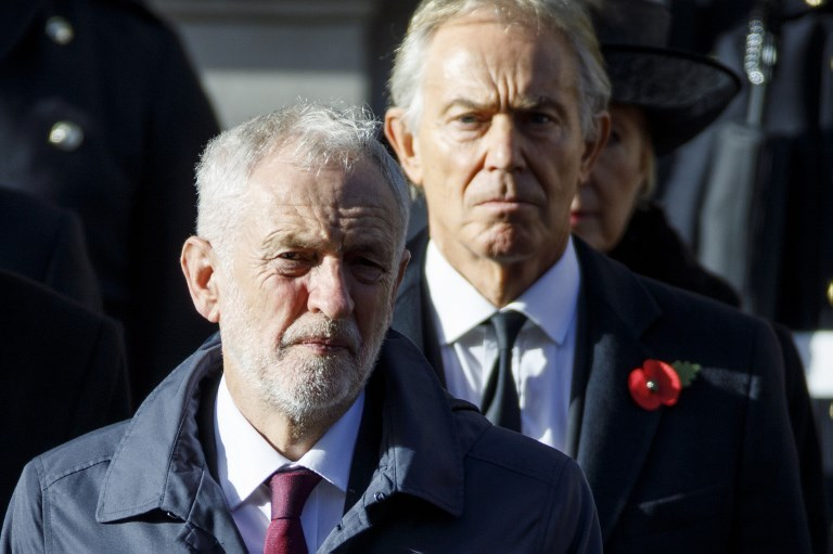 Corbyn and former British Prime Minister Tony Blair are pictured in London on 11 November (AFP)