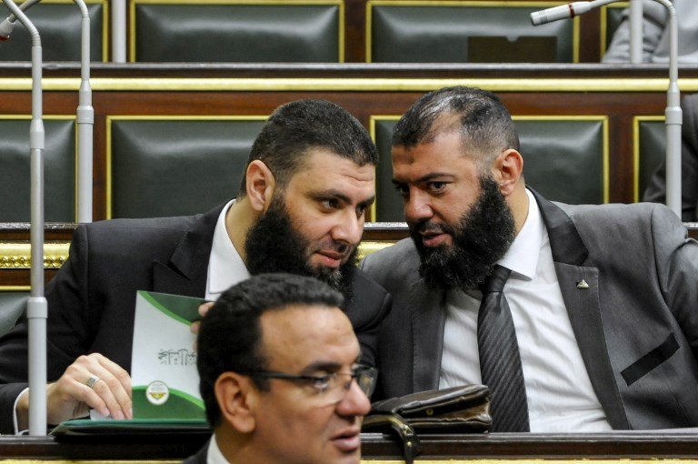 Members of Egypt's parliament attend a session to deliberate the proposed constitutional amendments in Cairo on 14 February (AFP)