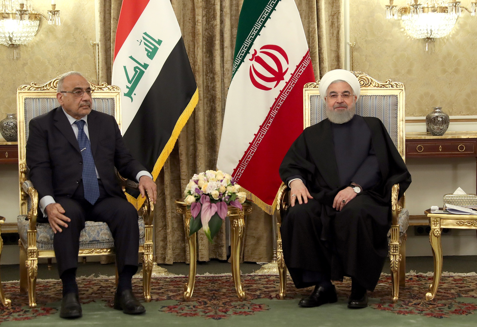 A handout picture provided by the Iranian presidency on April 6, 2019 shows Iranian President Hassan Rouhani (R) meeting with Iraqi Prime Minister Adel Abdel Mahdi in the Iranian capital Tehran (AFP)