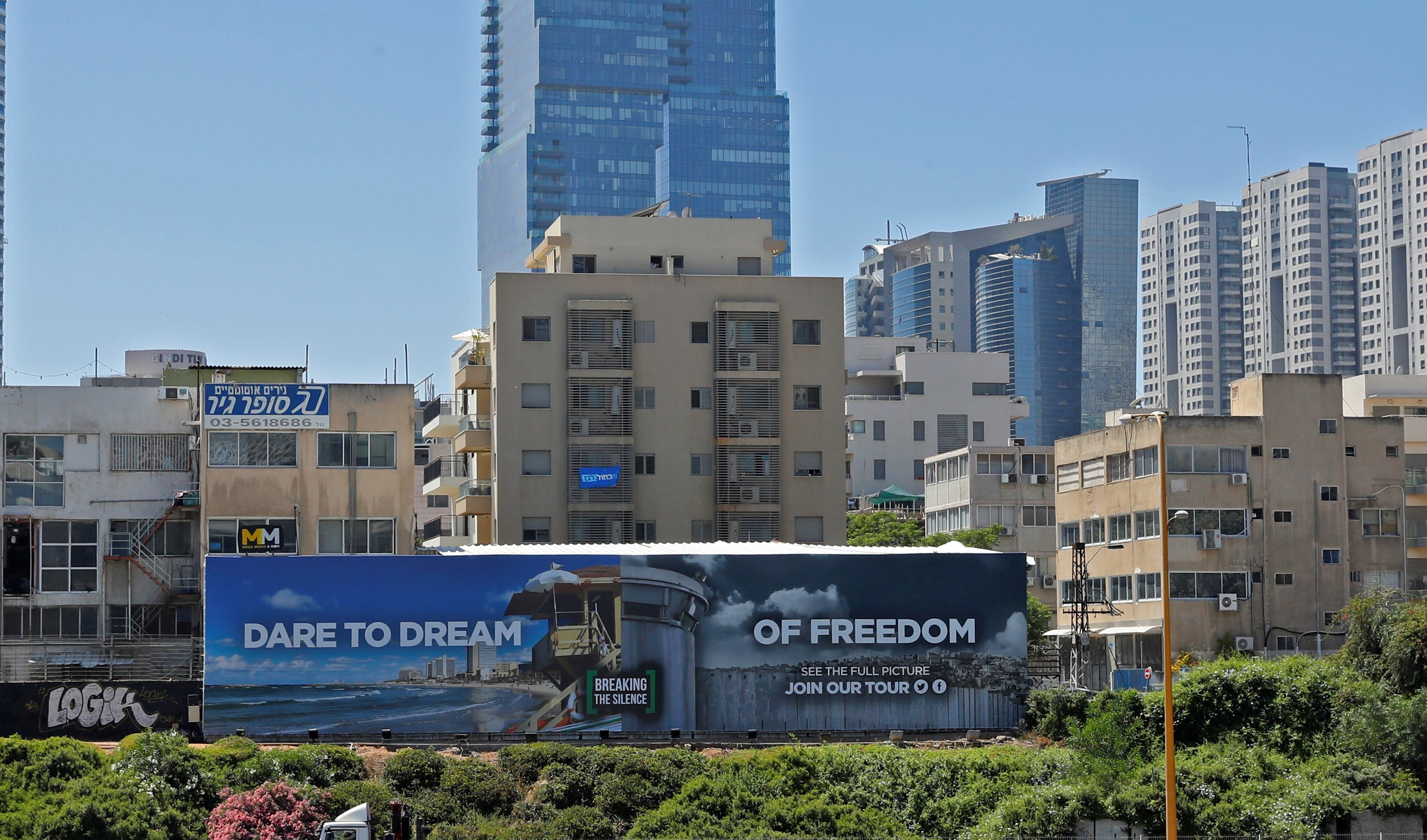 A picture taken on May 13, 2019, shows an anti-occupation billboard, by Israeli NGO Breaking The Silence, erected on a street in the Israeli coastal city of Tel Aviv (AFP)