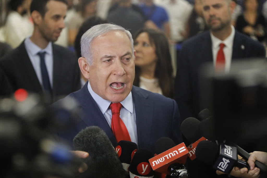 Israeli Prime Minister Benjamin Netanyahu talks to the press following a vote on a bill to dissolve the Knesset (Israeli parliament) on 29 May, 2019, at the Knesset in Jerusalem (AFP)