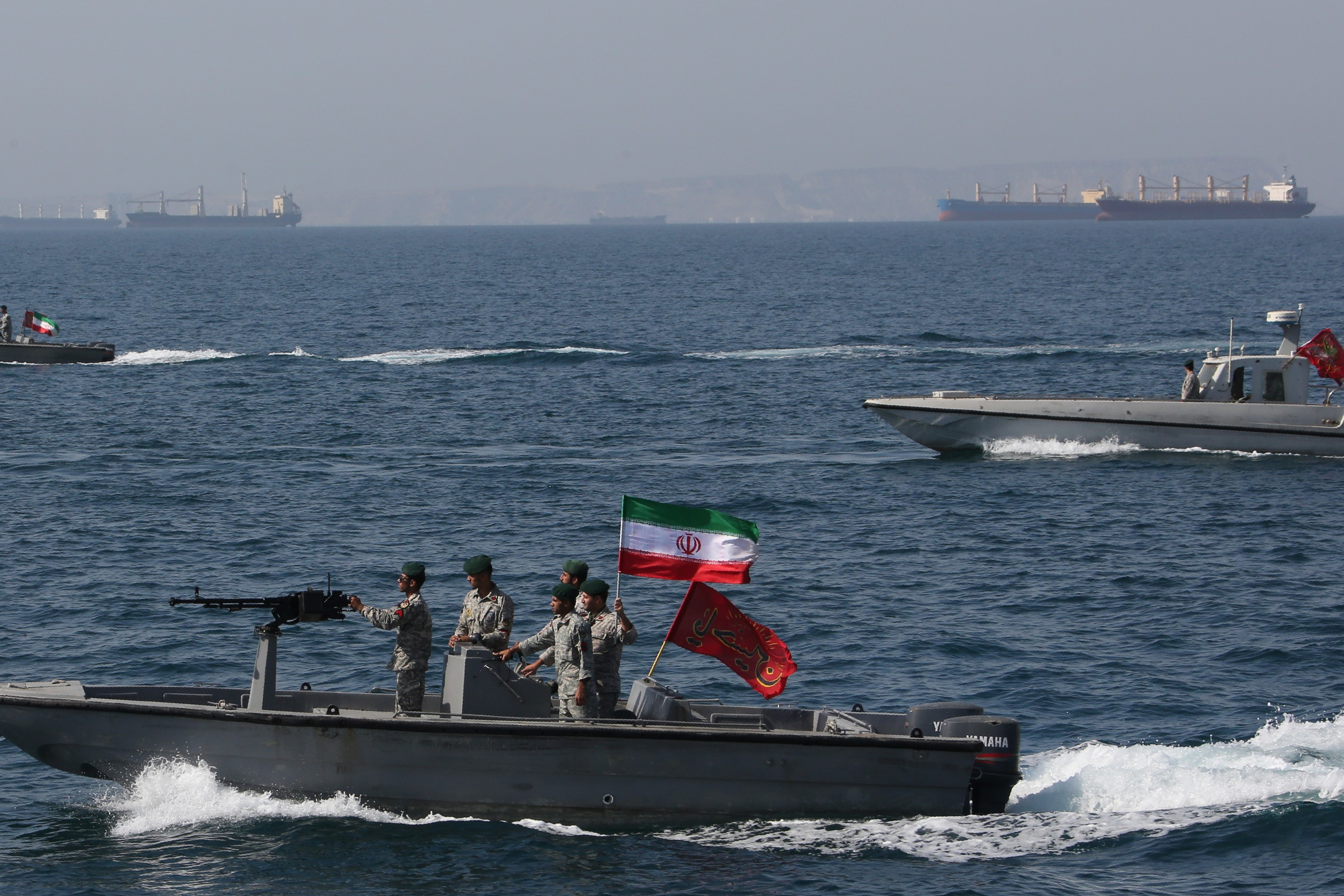 "In this file photo taken on April 30, 2019, Iranian soldiers take part in the ""National Persian Gulf day"" in the Strait of Hormuz (AFP)"