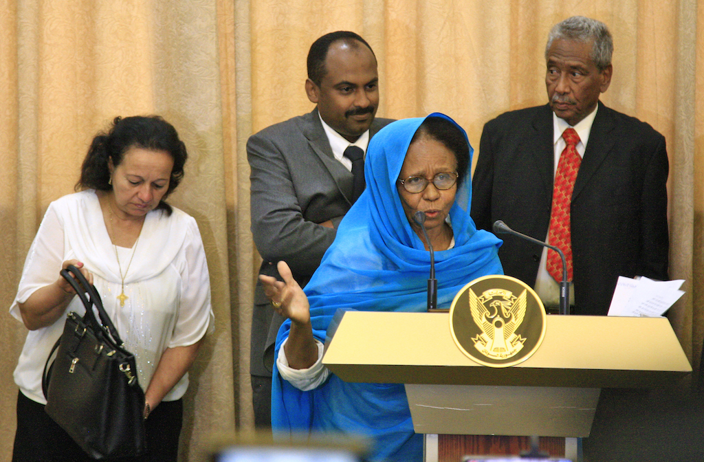 Aisha Mousa, a civilian member of Sudan's new sovereign council, speaks while flanked by other council members Raja Nicolas Abdel Massih, Mohamed al-Fakki Suleiman , and Hassan Idris (AFP)