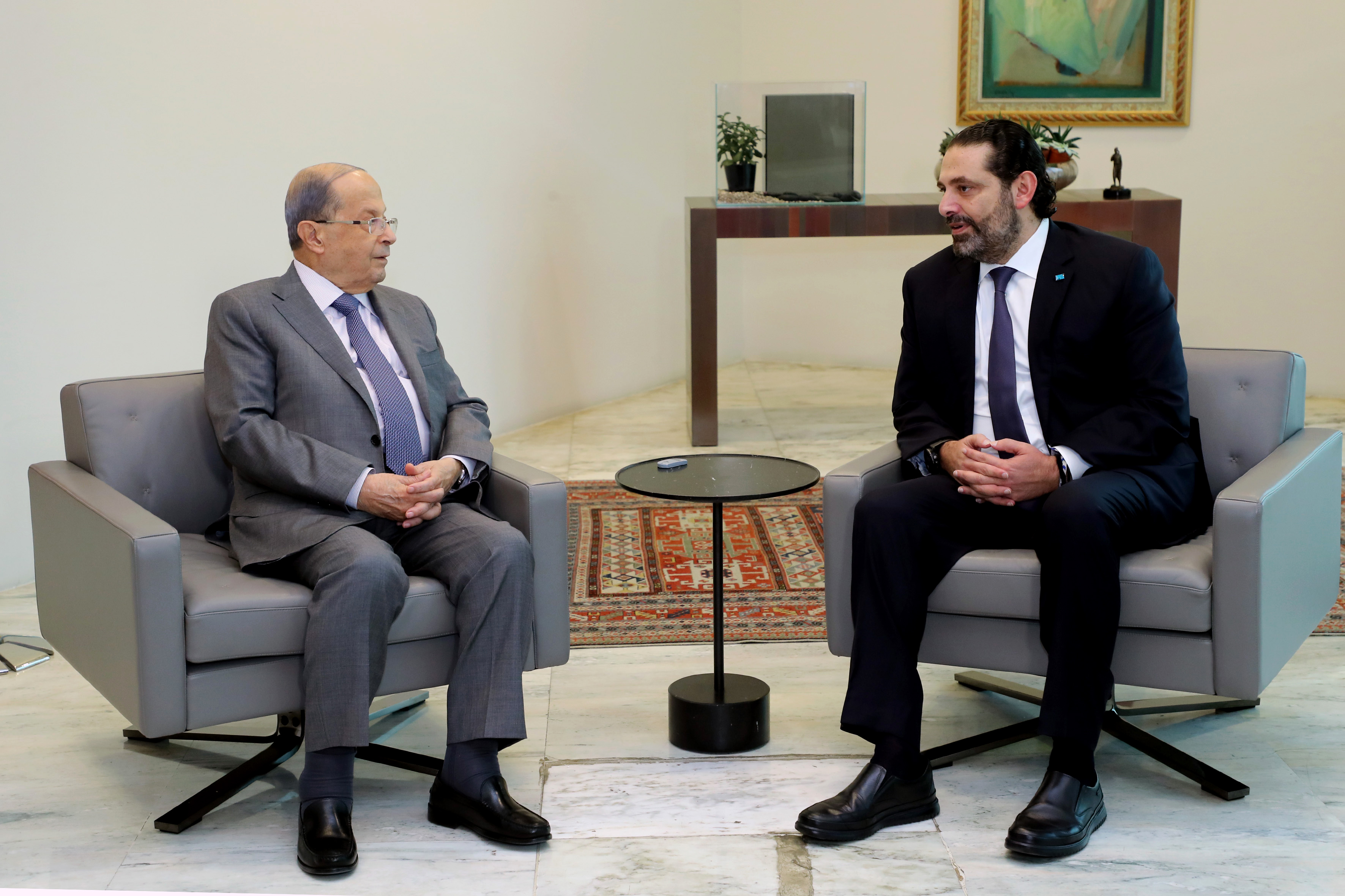 President Michel Aoun (L) meeting with caretaker prime minister Saad Hariri on 7 Novembver (AFP)