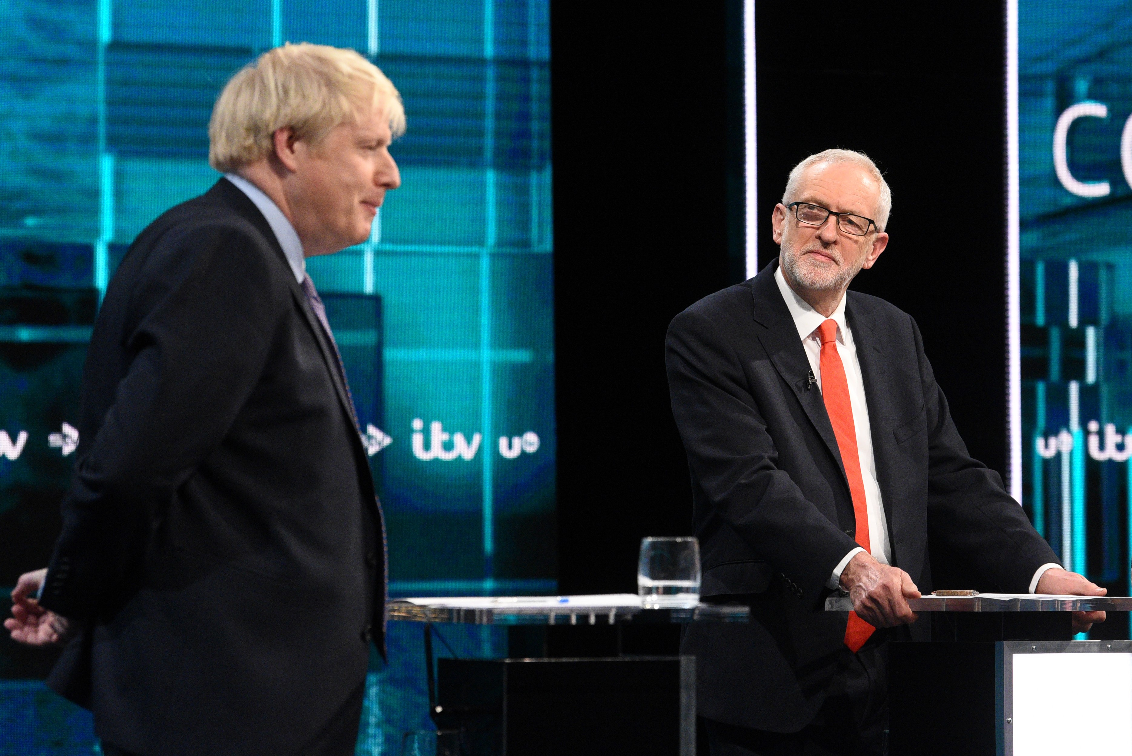 Britain's Prime Minister Boris Johnson (L) and Britain's Labour Party leader Jeremy Corbyn (R) as they debate on the ITV Debate on 19 November (AFP)