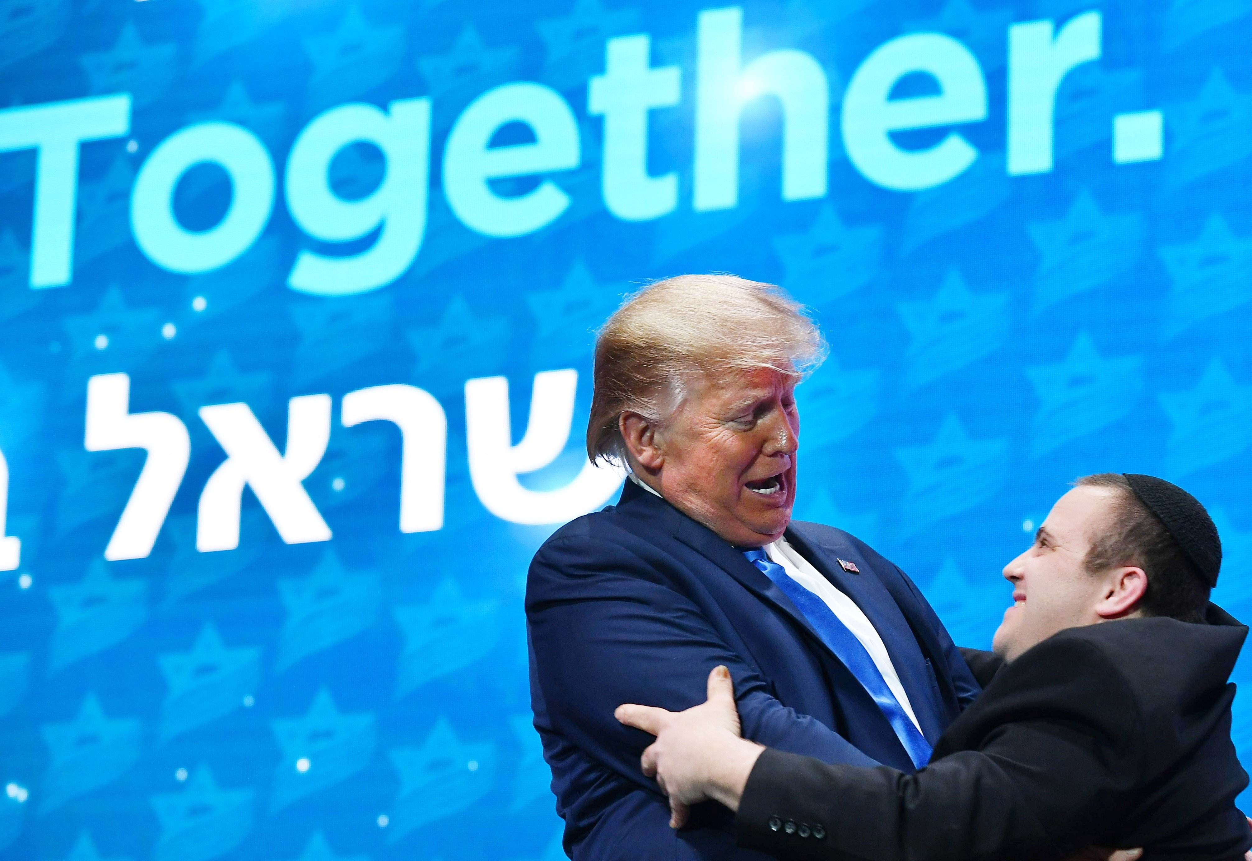 US President Donald Trump greets members of the Shalva Band after their performance at the Israeli American Council National Summit 2019 on 7 December (AFP)