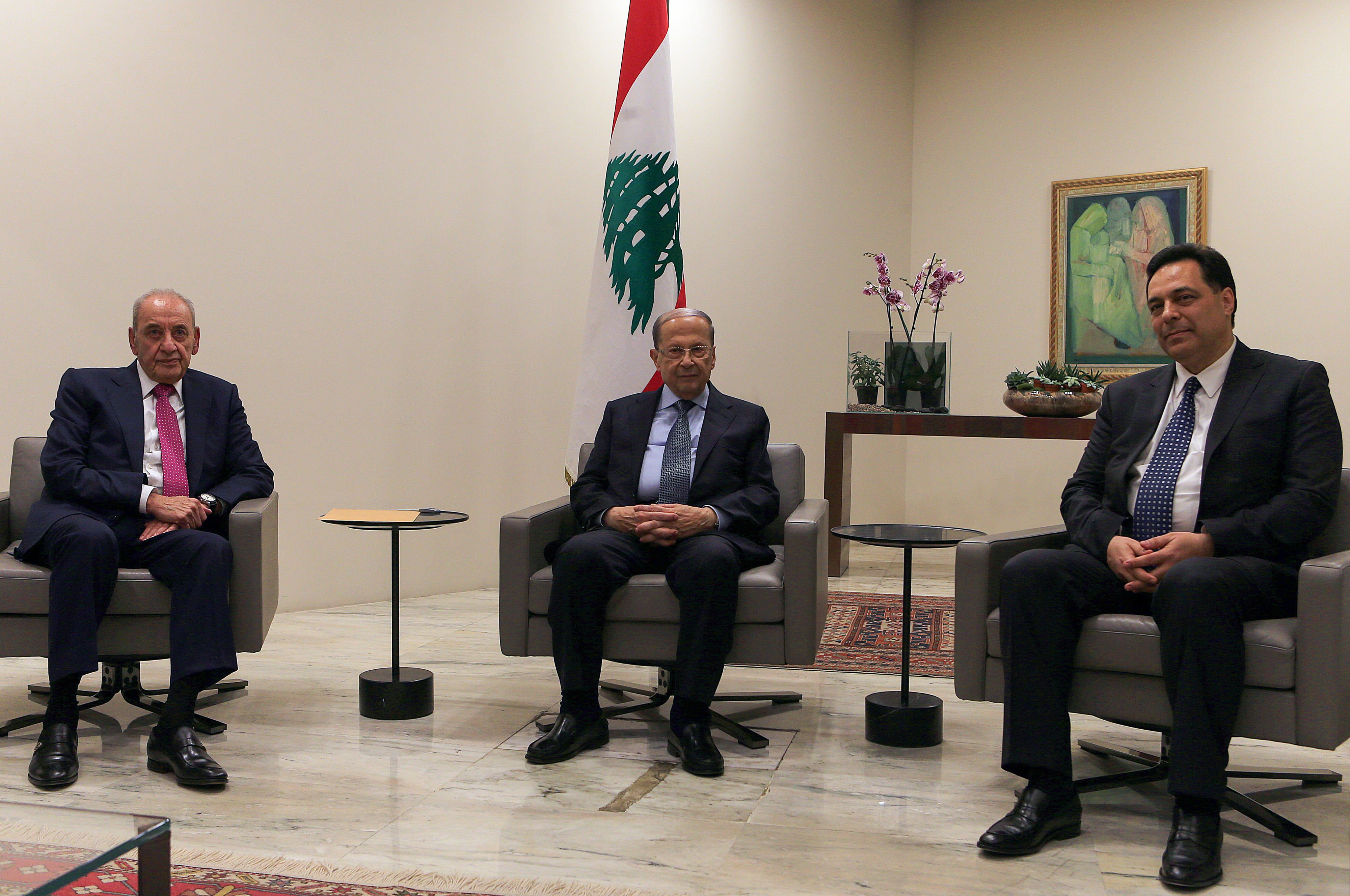Lebanese President Michel Aoun (C) meets with Prime Minister-designate Hassan Diab (R) and Parliament Speaker Nabih Berri at the presidential palace in Baabda (AFP)
