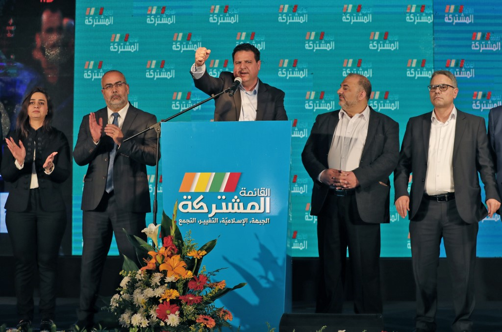 Ayman Odeh (C), leader of the Hadash party that is part of the Joint List alliance, gives an address with other alliance leaders at their electoral headquarters in Israel's northern city of Shefa-Amr on March 2, 2020,