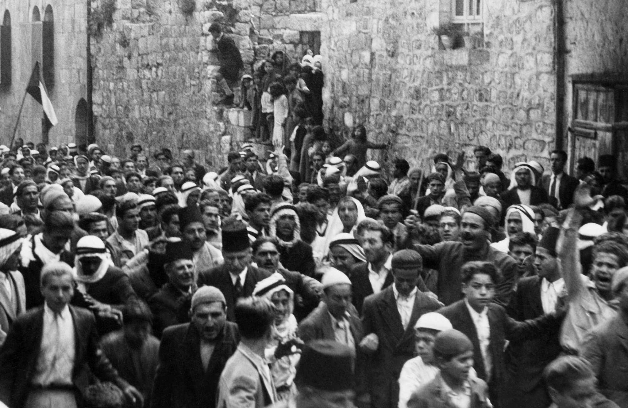 A picture dated before 1937 during the British Mandate in Palestine shows Arabs demonstrating in the Old City of Jerusalem against the Jewish immigration to Palestine.