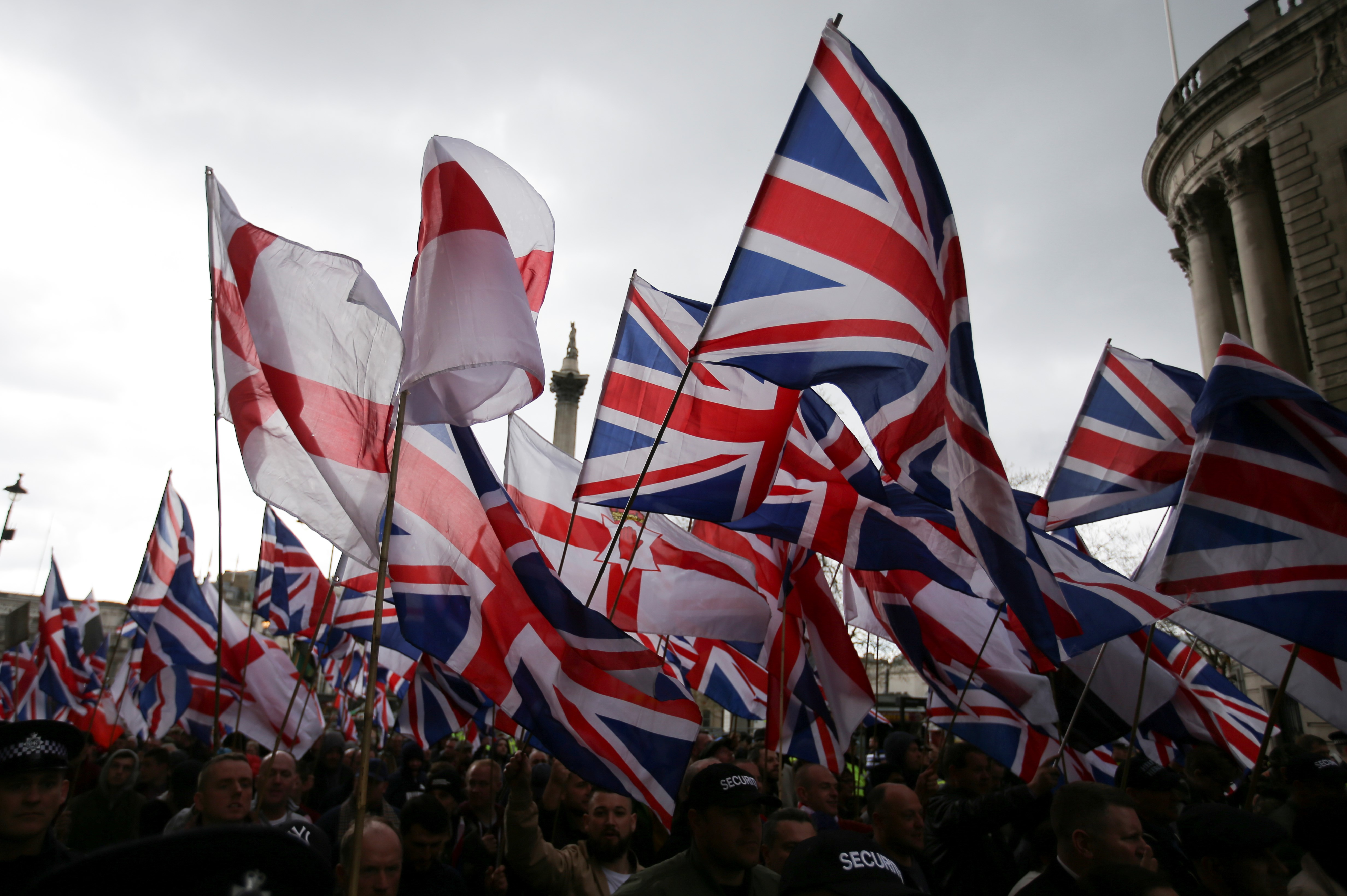 Supporters of the far-right group Britain First wave flags as they march and rally in central London on 1 April, 2017 (AFP)