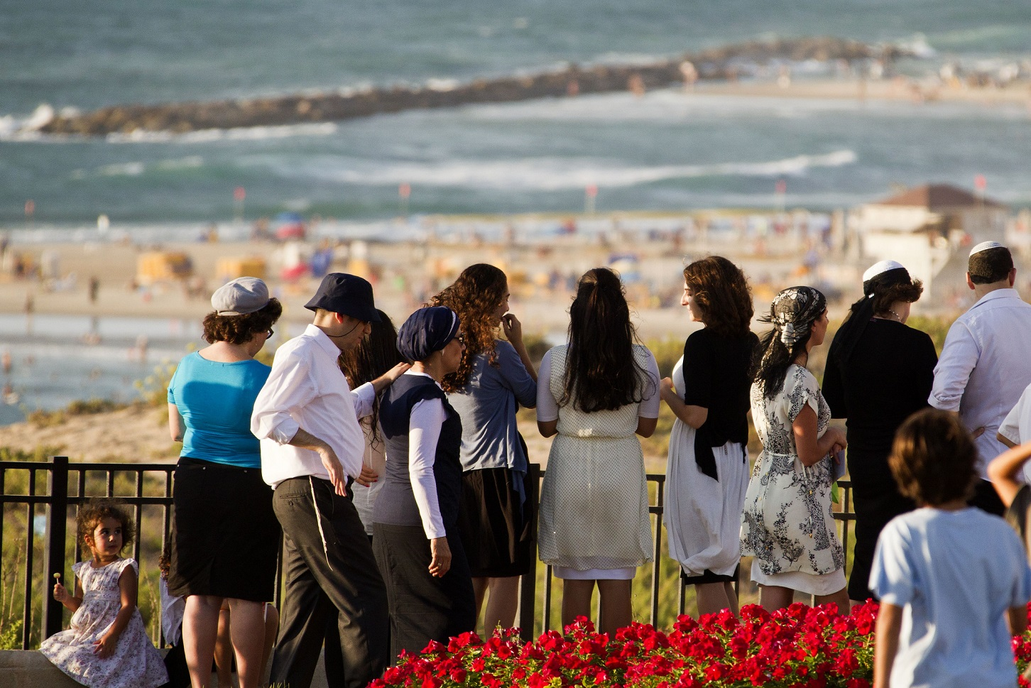 Religious Jews read the Tashlich prayer in the Israeli coastal city of Netanya in celebration of Rosh Hashana on 5 September 2013 (AFP)