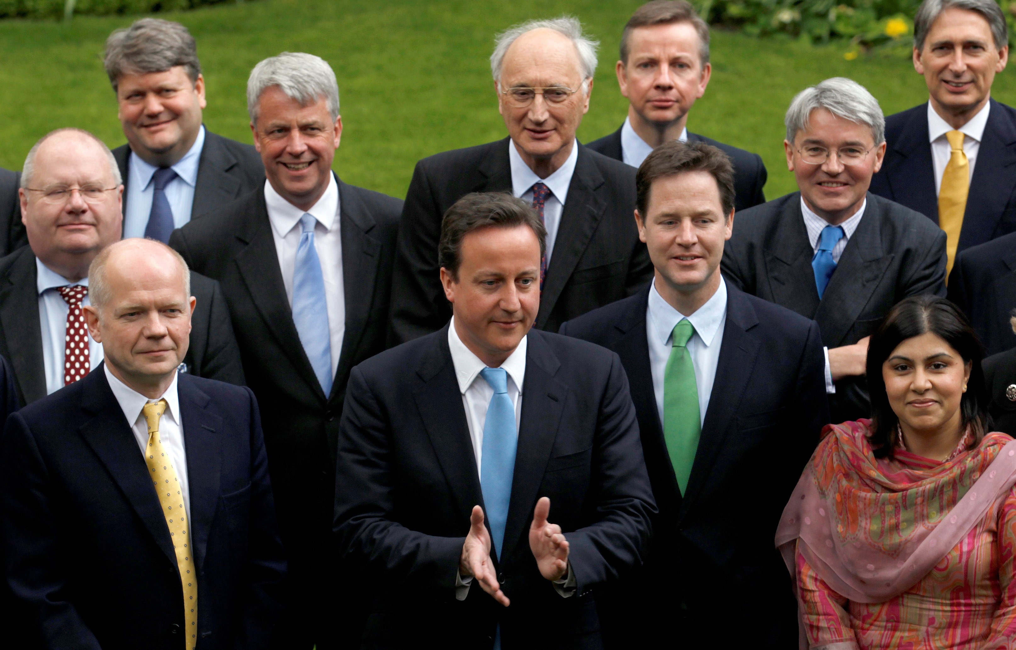 Britain's Prime Minister David Cameron in a group picture with his new cabinet in the garden of 10 Downing Street in London May,2010 (Reuters)