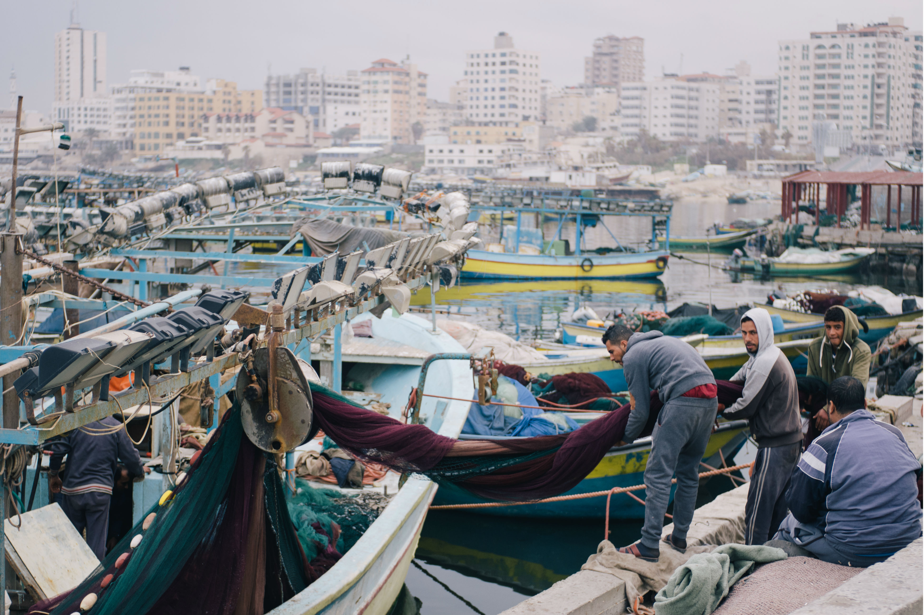 In the morning, when the air is still heavy with moisture, fishermen board small trawlers and set out from Gaza City's port to search for a catch within the six nautical miles that Israel allows them to fish