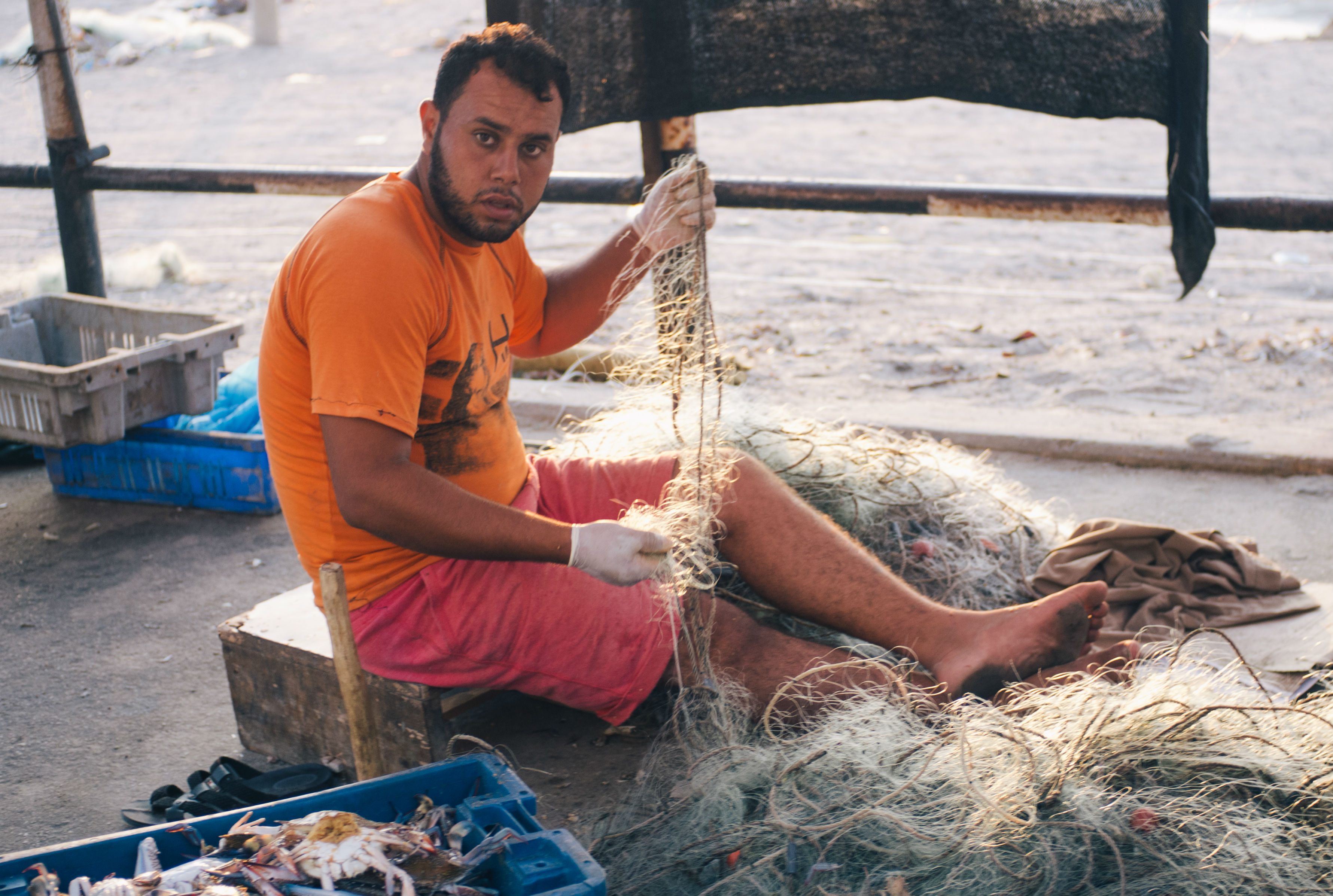 Gaza's connection to the sea may be the strongest in the Shati refugee camp, named after the coast on which it sits. Everywhere there are fishermen, either preparing to go out to sea or else returning with hauls that they sell on the roadside while they fix their nets