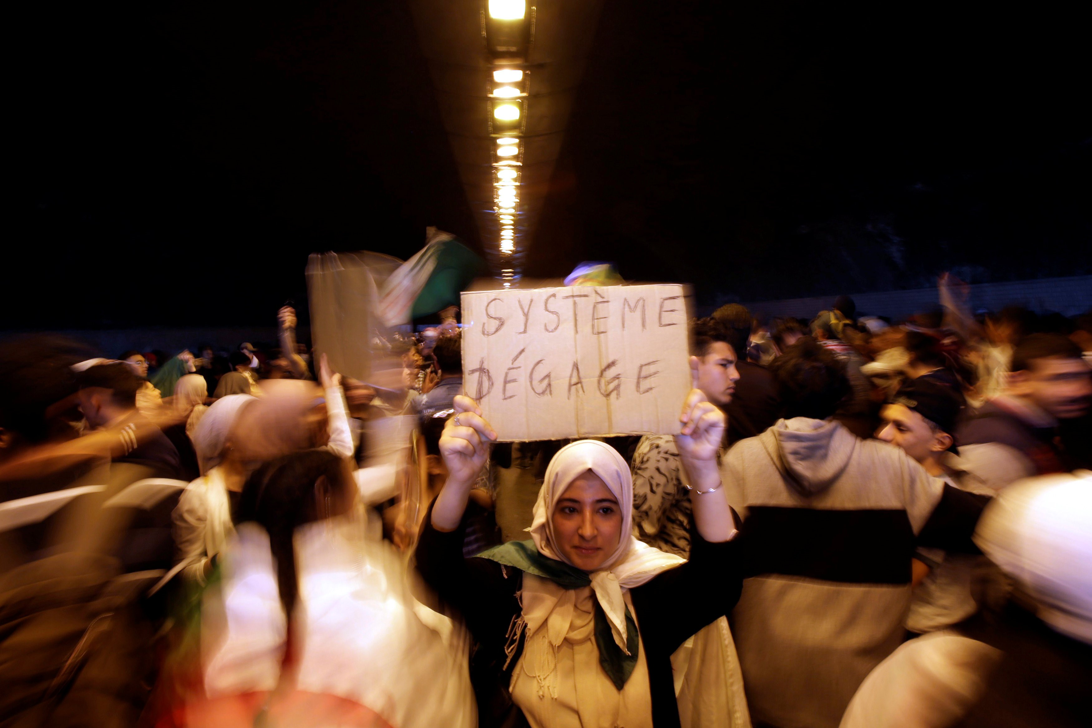 People take part in a protest demanding immediate political change in Algiers, Algeria 12 March 2019 (Reuters)