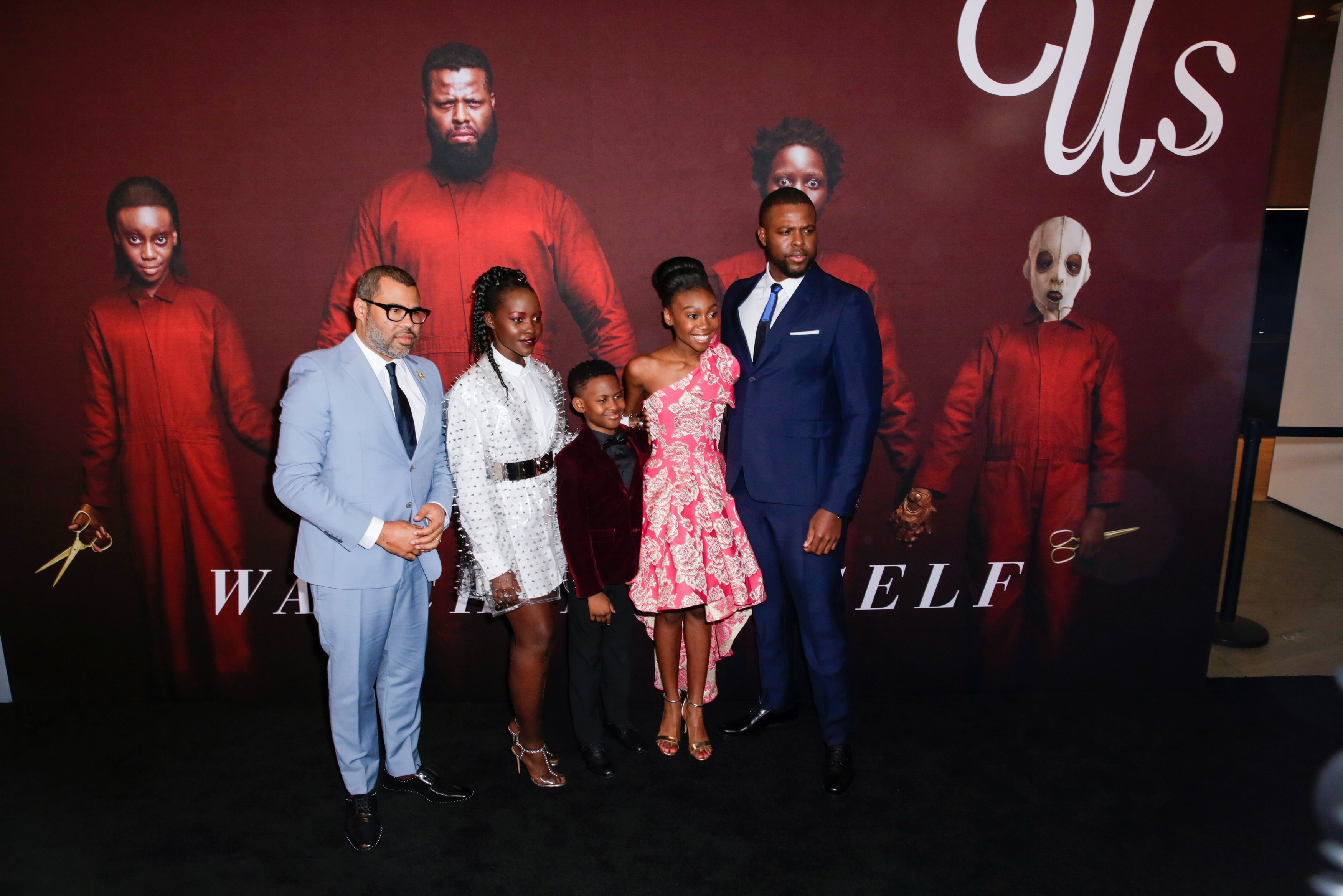 "Director Jordan Peele (L) and cast members attend the ""Us"" premiere at The Museum of Modern Art in New York City on 19 March (REUTERS)"