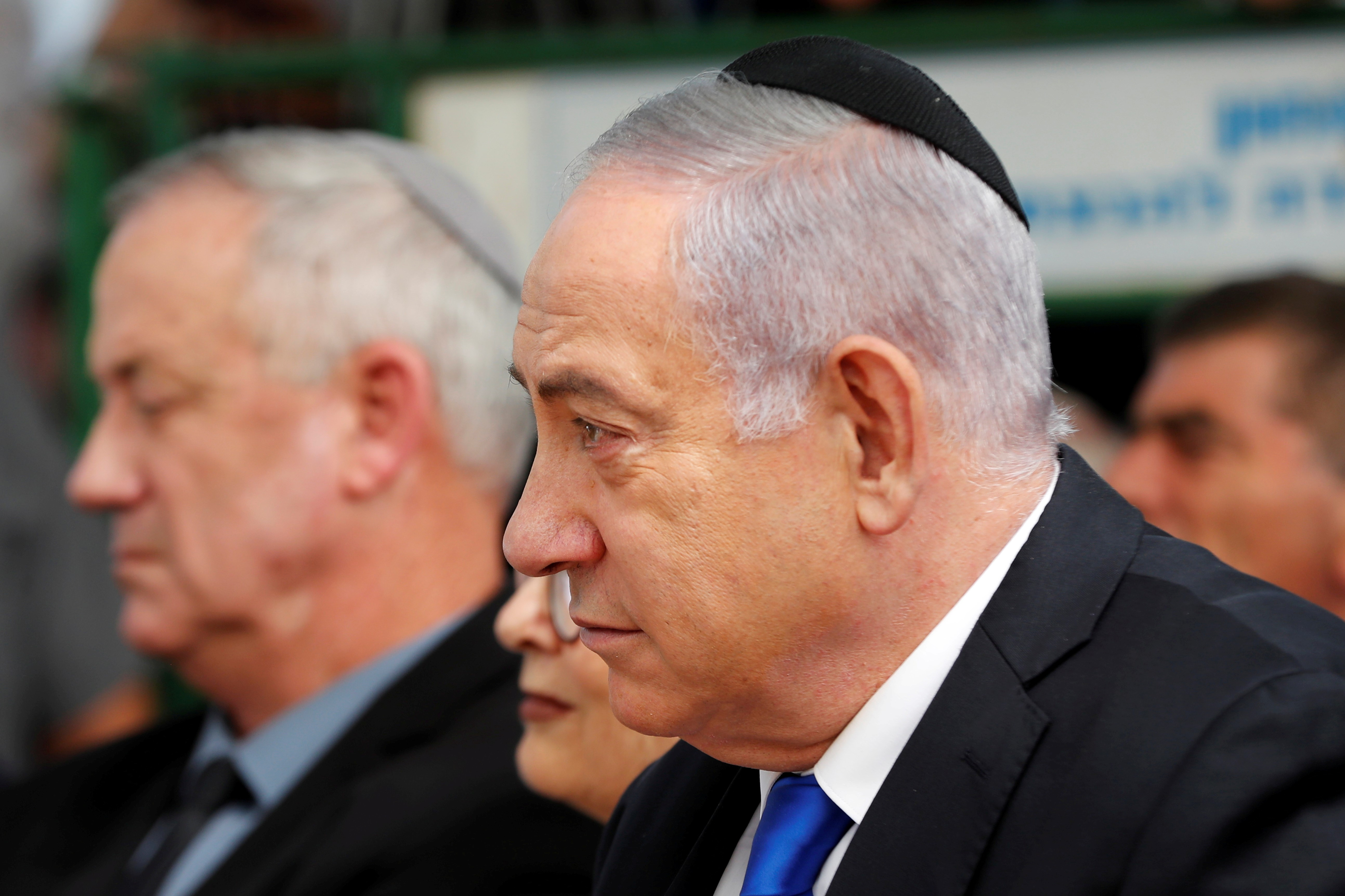 Israeli Prime Minister Benjamin Netanyahu sits next to Benny Gantz, leader of the Blue and White party on 22 September (Reuters)