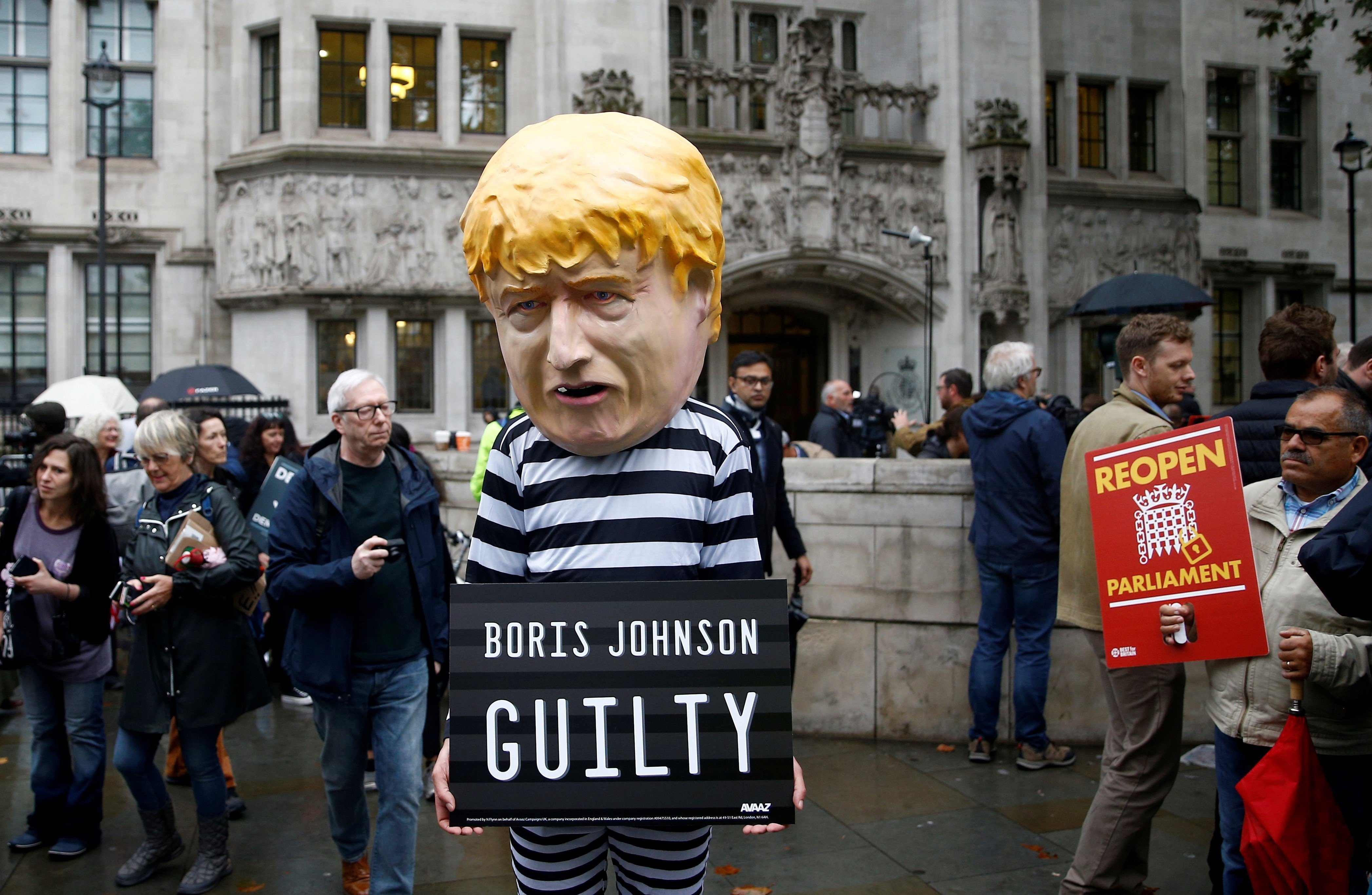 A protester stands outside the Supreme Court of the United Kingdom on 24 September (Reuters)