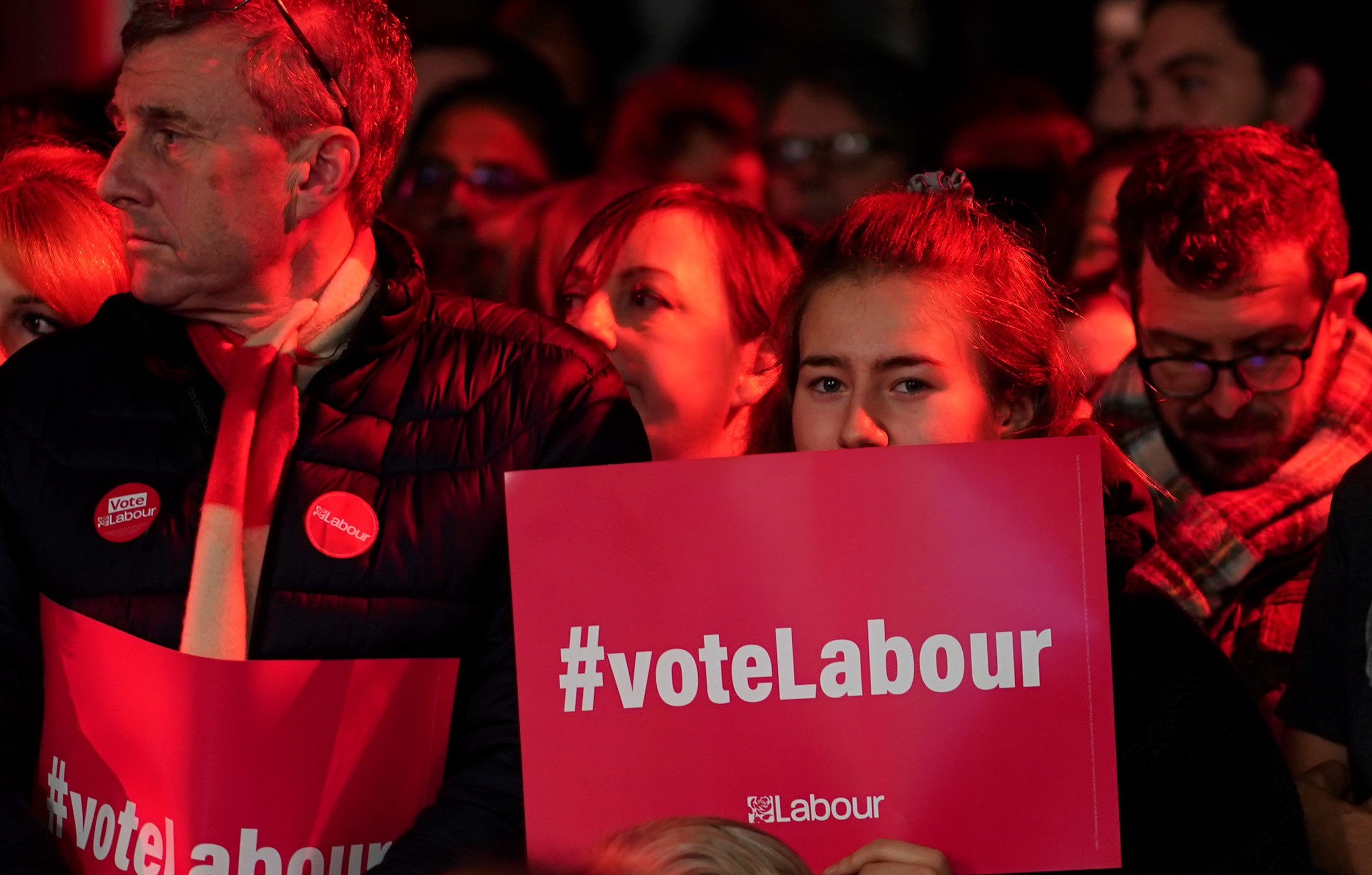 Supporters gather inside the venue of Britain's opposition Labour Party leader Jeremy Corbyn's final general election campaign event in London, Britain on 11 December (Reuters)