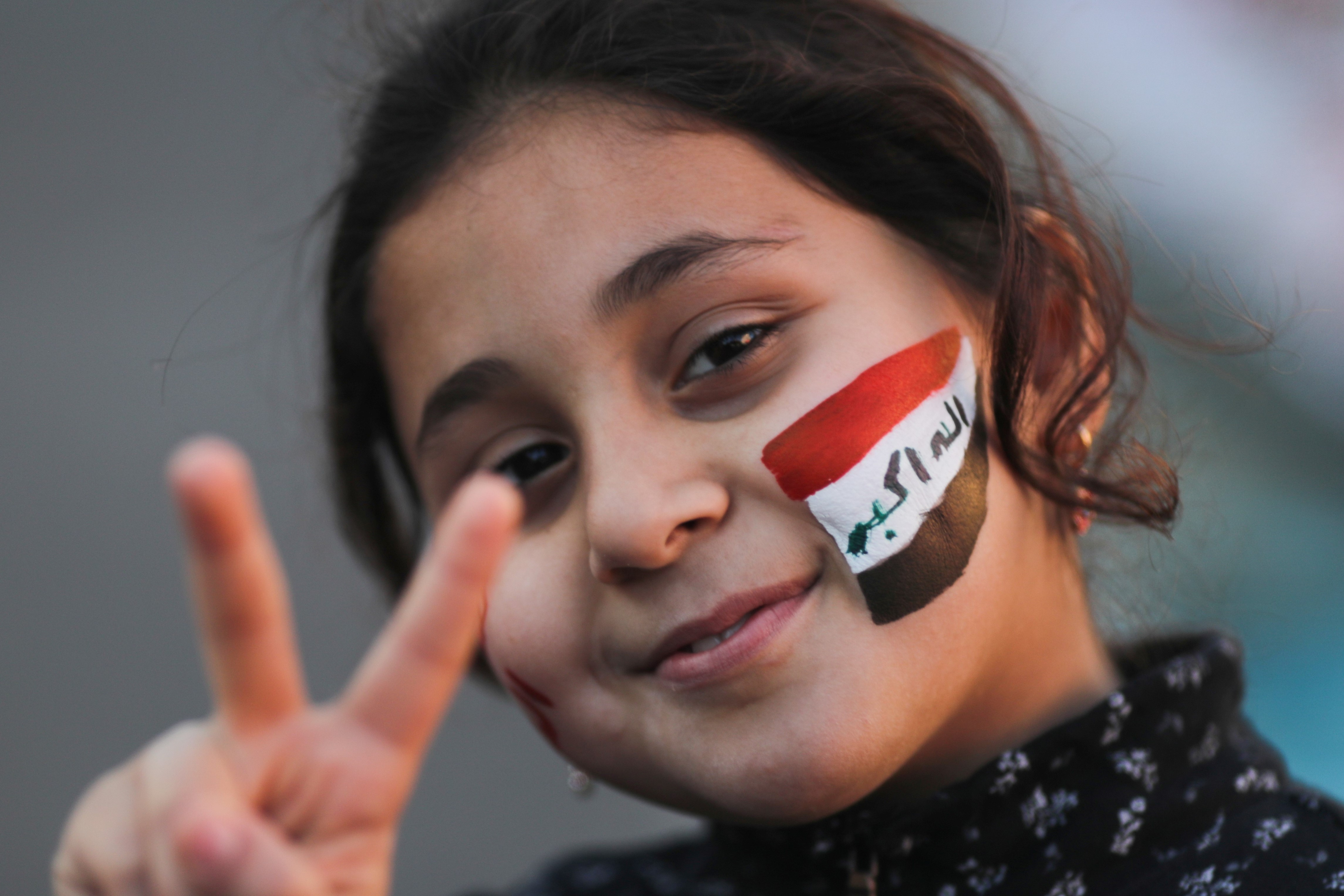 An Iraqi girl gestures during ongoing anti-government protests in Baghdad, Iraq December 20, 2019. REUTERS