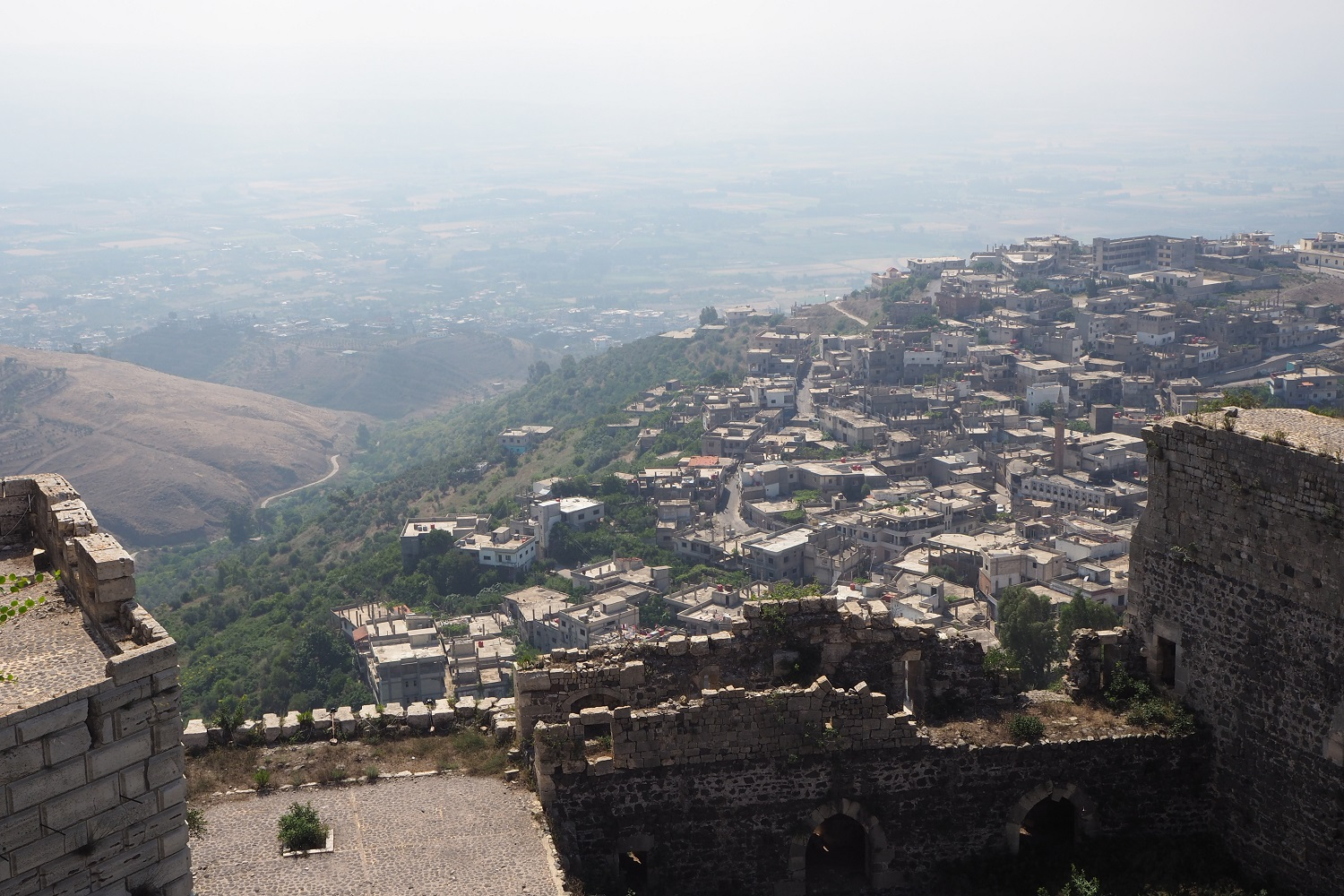 The view looking down on the small town of Al-Husan, where many of the castle workers live (Tom Westcott/MEE)