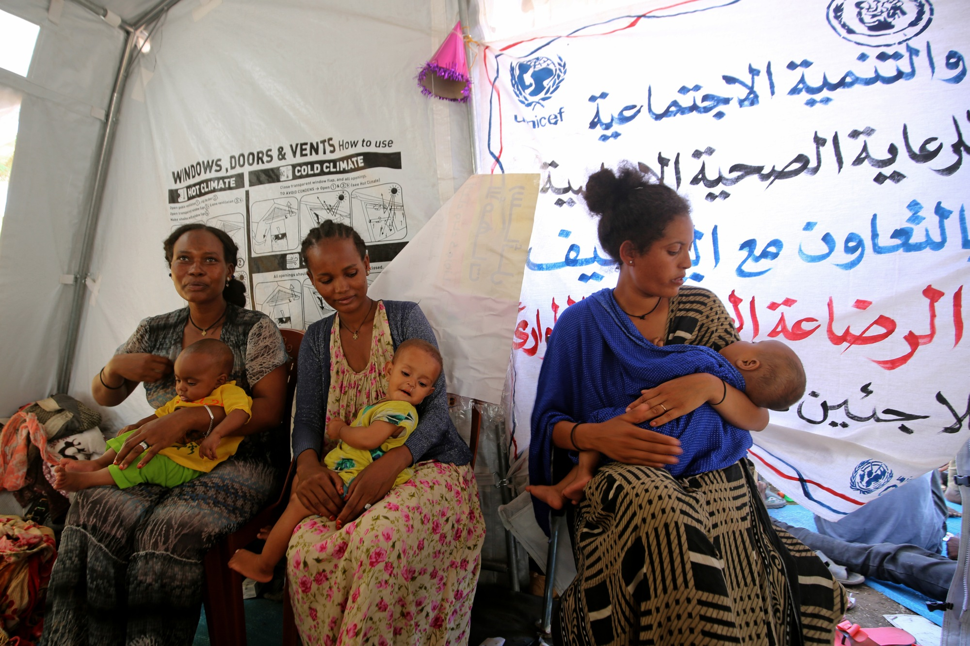 Ethiopian refugees who fled the fighting in the Tigray receive maternity care in the Hamdaiet area of Sudan's eastern Kassala state on 22 November 2020 (AFP)