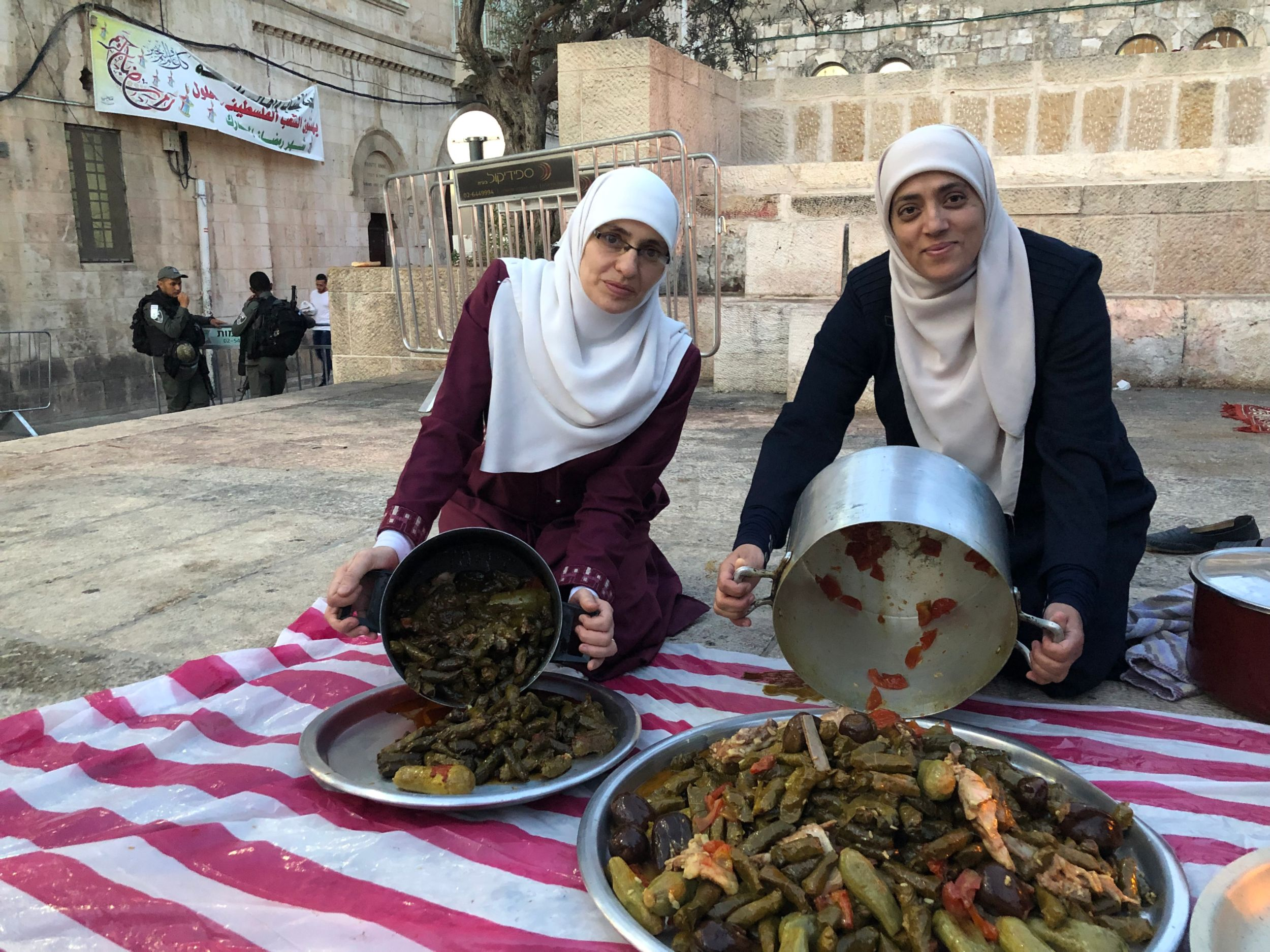 Halawani, left, and Khweiss organised iftars outside of Al-Aqsa during the Muslim holy month of Ramadan (MEE/Juman Abu Arafeh)