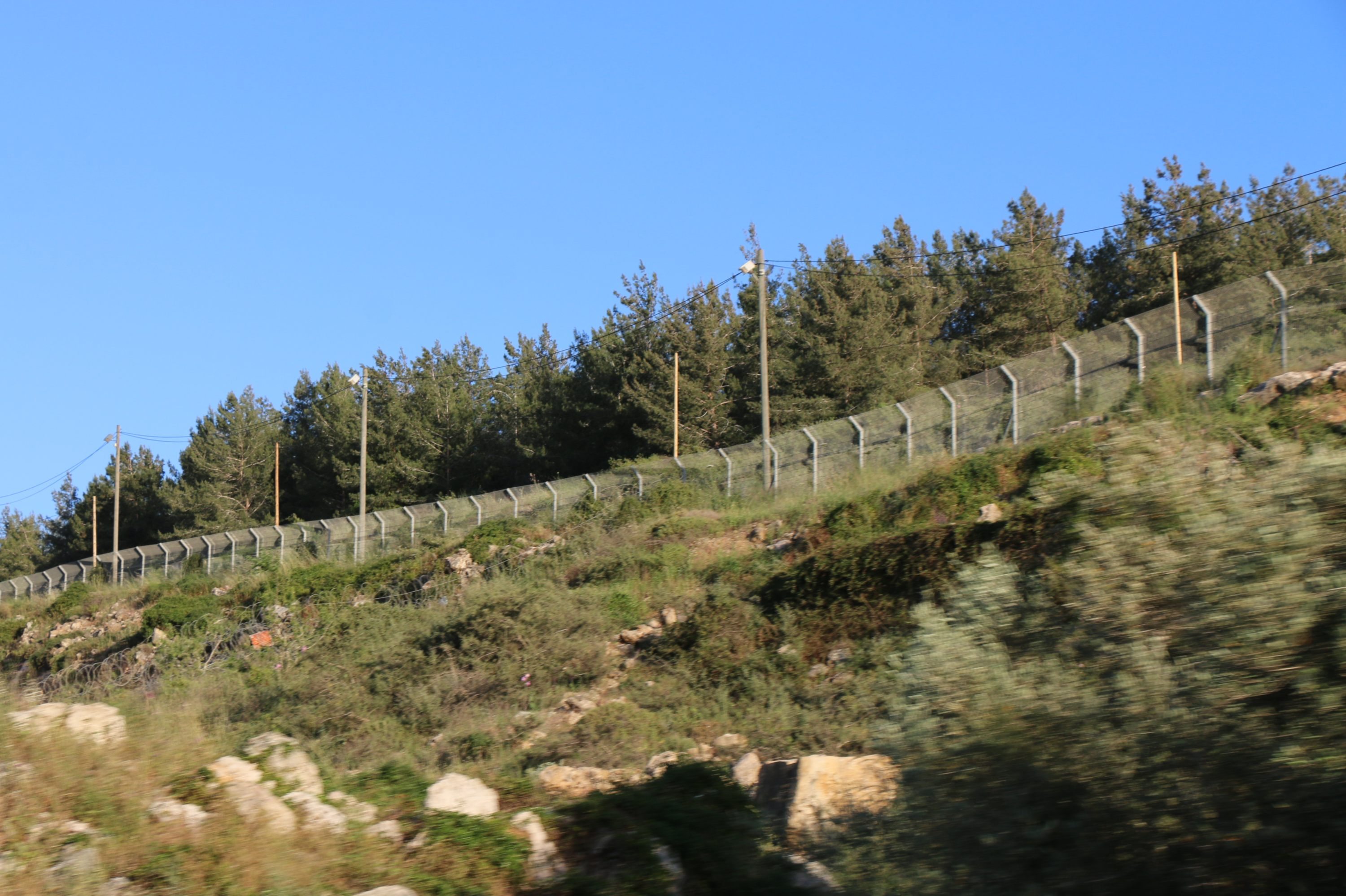 An Israeli fence runs through the Yousif family's land near the illegal Israeli settlement of Ariel (MEE/Akram al-Waara)