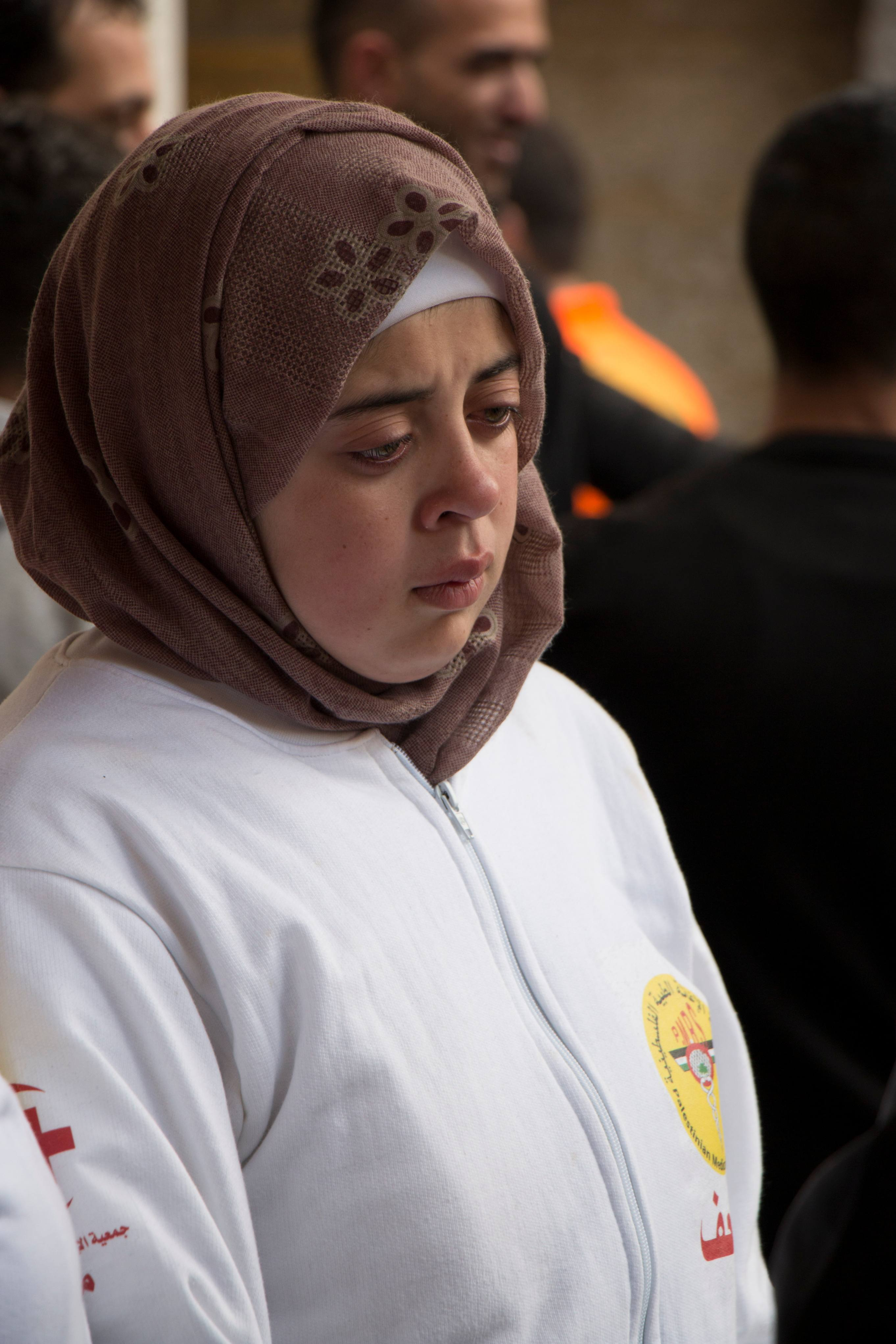 """You could have put him in clashes on his own, and he would have been able to care for all the injured by himself,"" says Salsabil al-Tamimi of her friend and fellow paramedic Sajid Mizher (MEE/Akram al-Waara)"