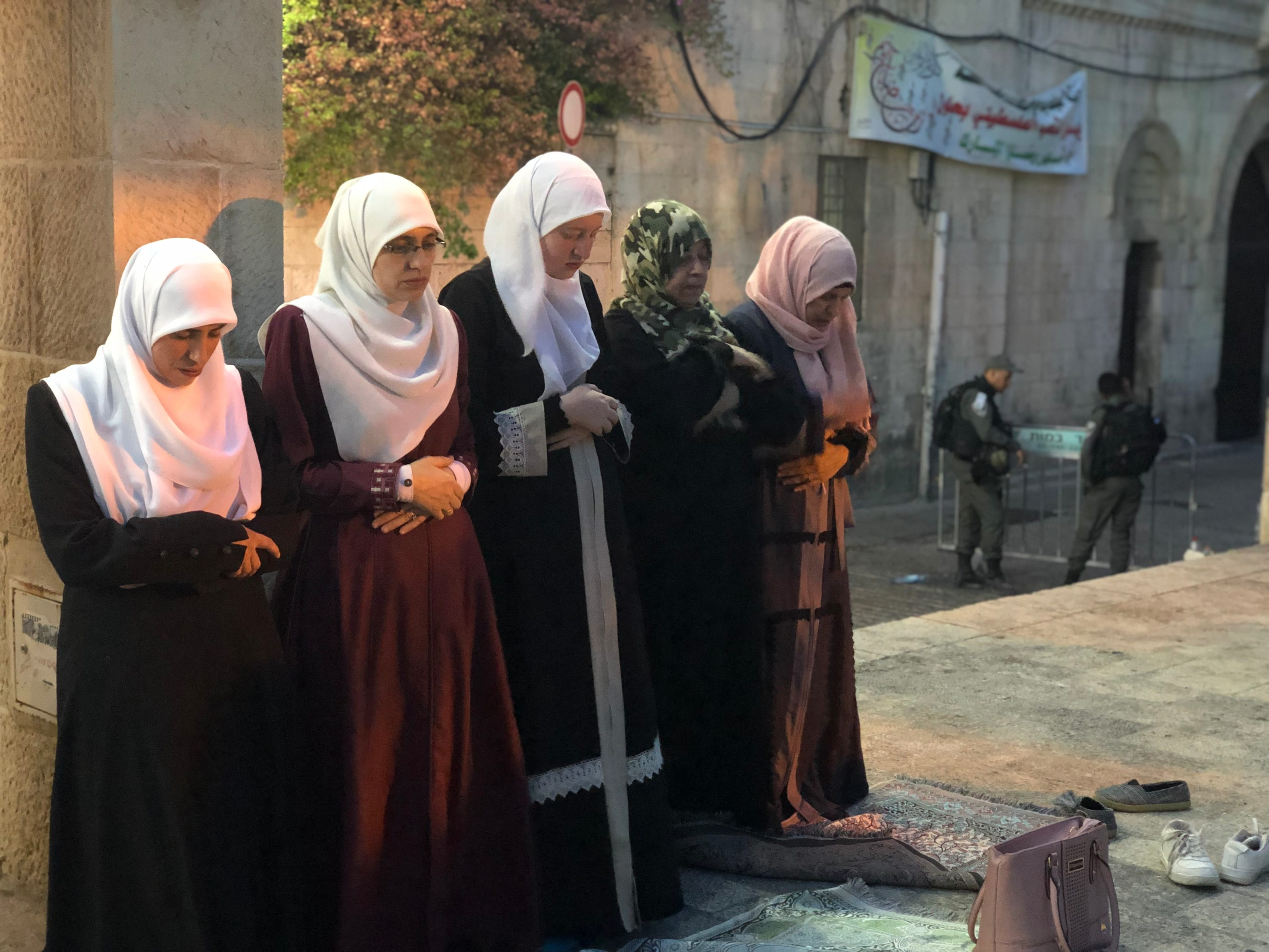 Women praying outside Al-Aqsa MEE Juman Abu Arafeh