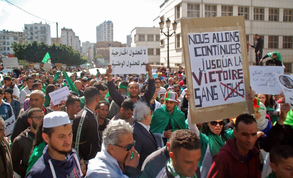 Algerians take part in an anti-government protest in Oran on 9 April (AFP)