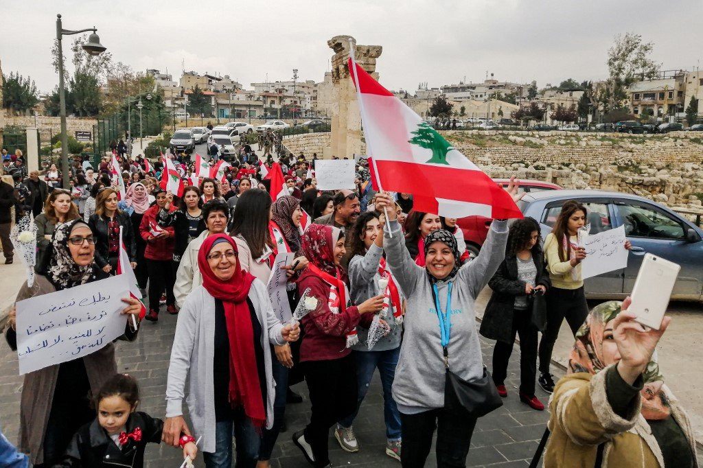 Lebanese people demonstrate in the Bekaa Valley city of Baalbek on 26 October (AFP)