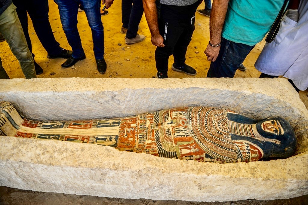 Sarcophagus discovered at Dahshur necropolis is examined near Bent Pyramid on Saturday (AFP)