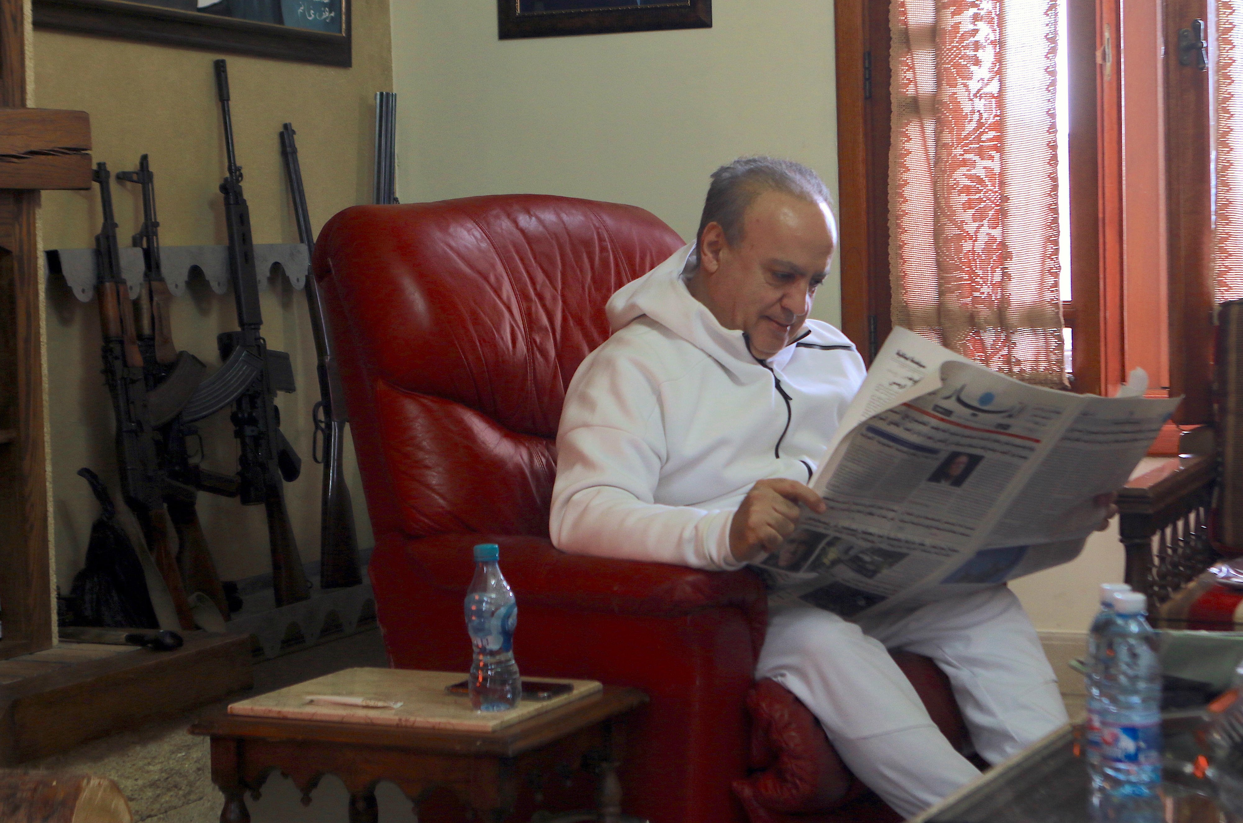 Wiam Wahhab reads a Lebanese newspaper in his home in Jahlieh (MEE/Michal Kranz)
