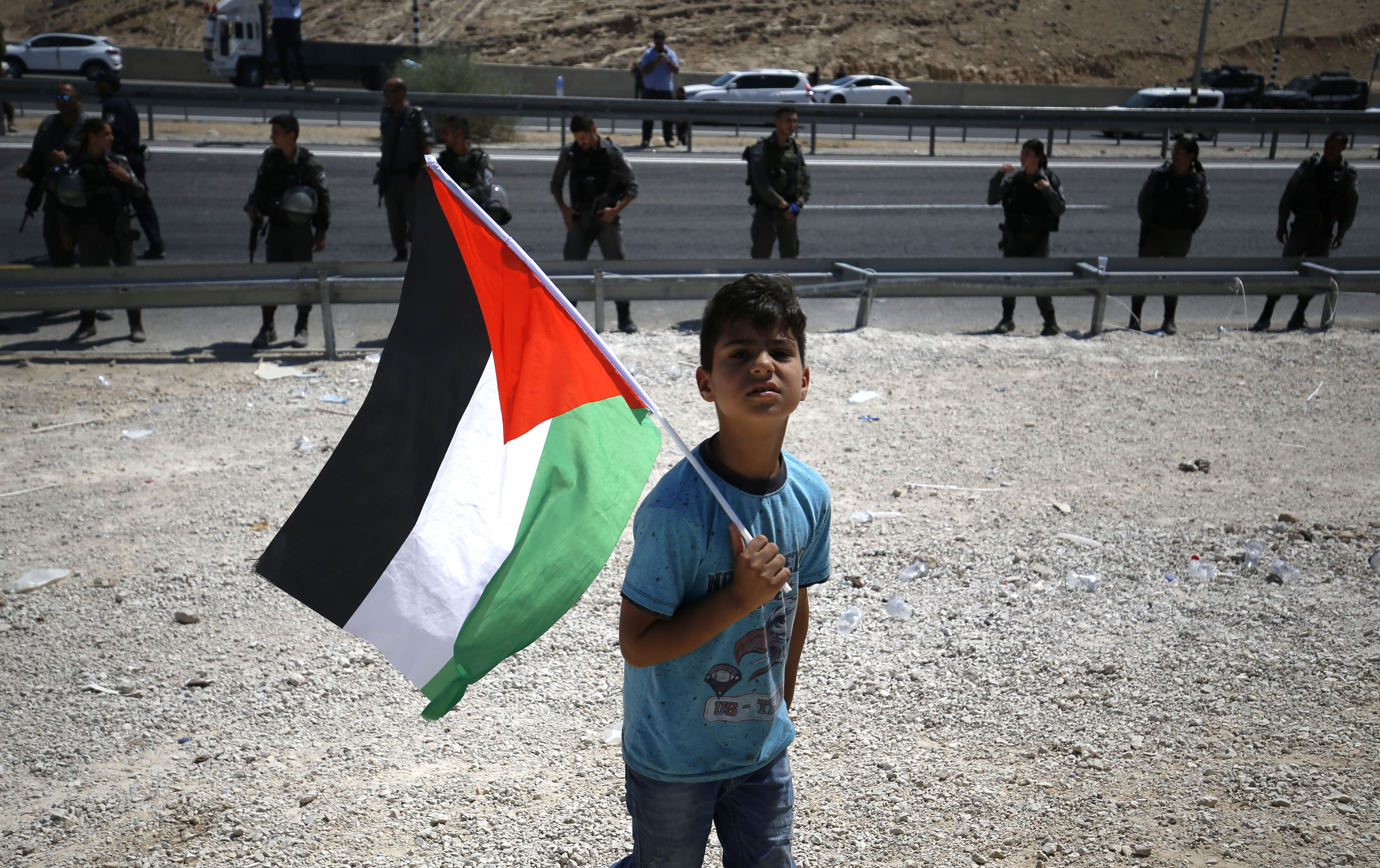 A child protests against the planned demolition of the Palestinian village of Khan al-Ahmar (AFP)
