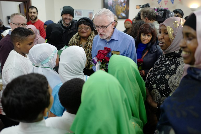 Corbyn meets worshippers on 'Visit my Mosque Day' in London on 3 March (AFP)