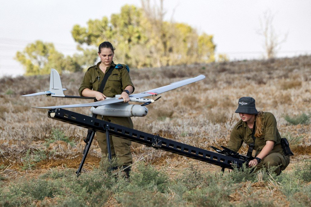 An Israeli soldier prepares an Elbit Systems Skylark I unmanned aerial vehicle (UAV or drone) for take-off near the border with the Gaza Strip in southern Israel on August 21, 2020, as part of monitoring operations in the area.