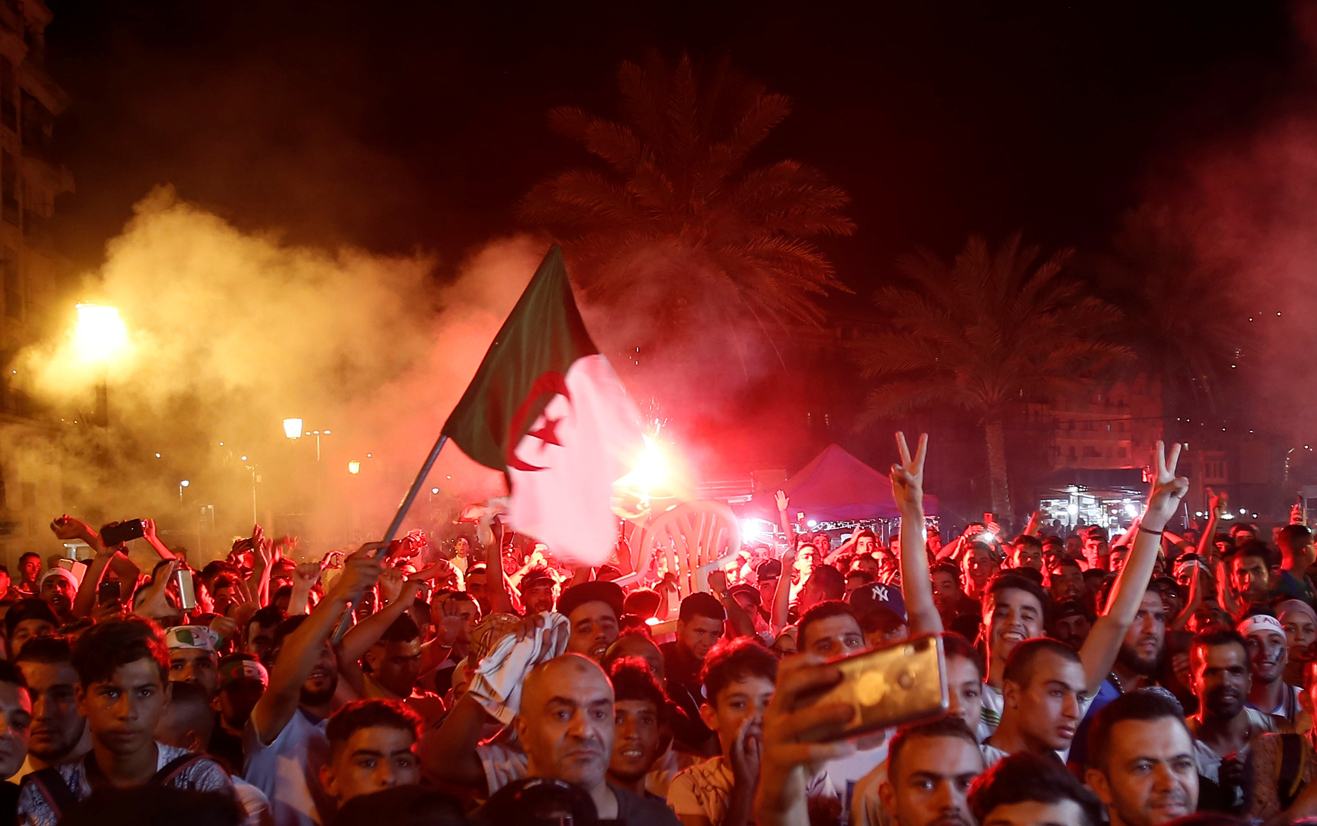 Fans in capital Algiers celebrate Algeria's victory in African Cup of Nations (Reuters)