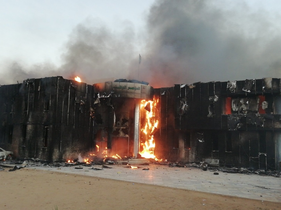 Images circulated on social media showing the Sudanese ruling party's offices on fire in Atbara (Twitter)