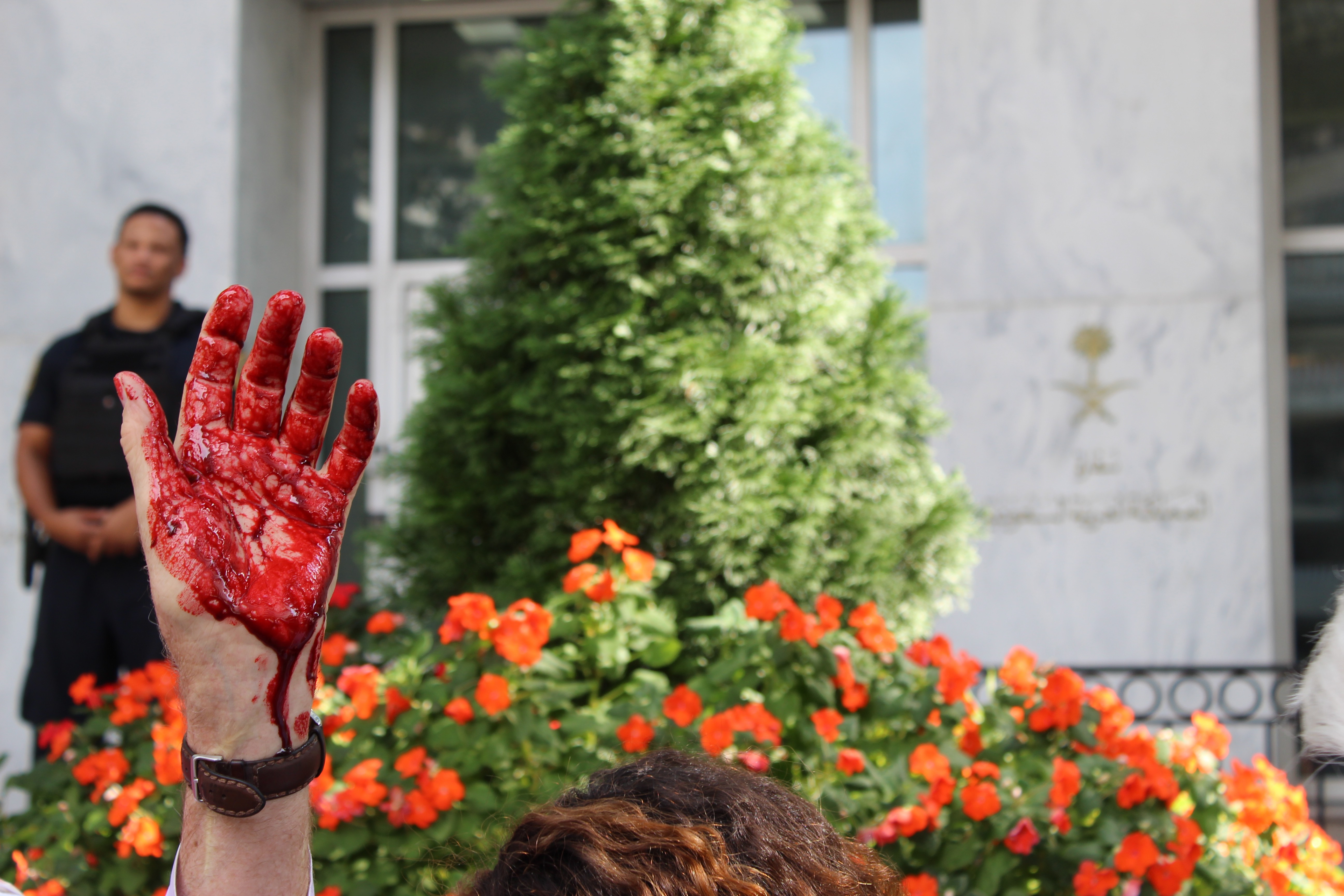 One protester dressed up like Saudi's MBS, covering his hands in blood (MEE/Sheren Khalel)