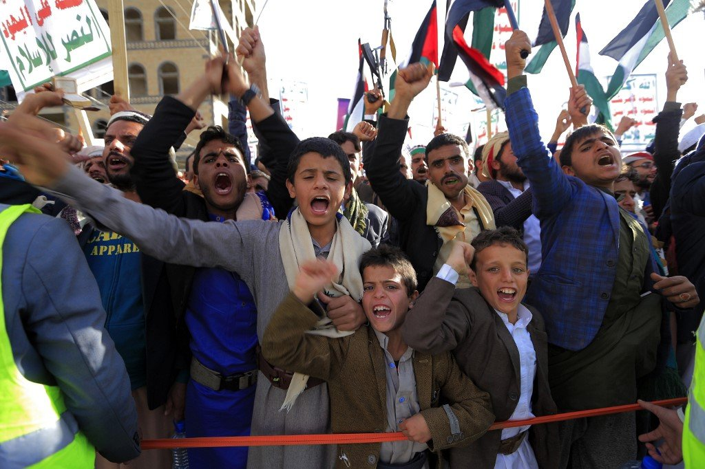 Young Yemeni supporters of the Huthi rebels chant slogans and wave Palestinian flags as they attend a pro-Palestinian rally in the rebel-held capital Sanaa on January 31, 2020,