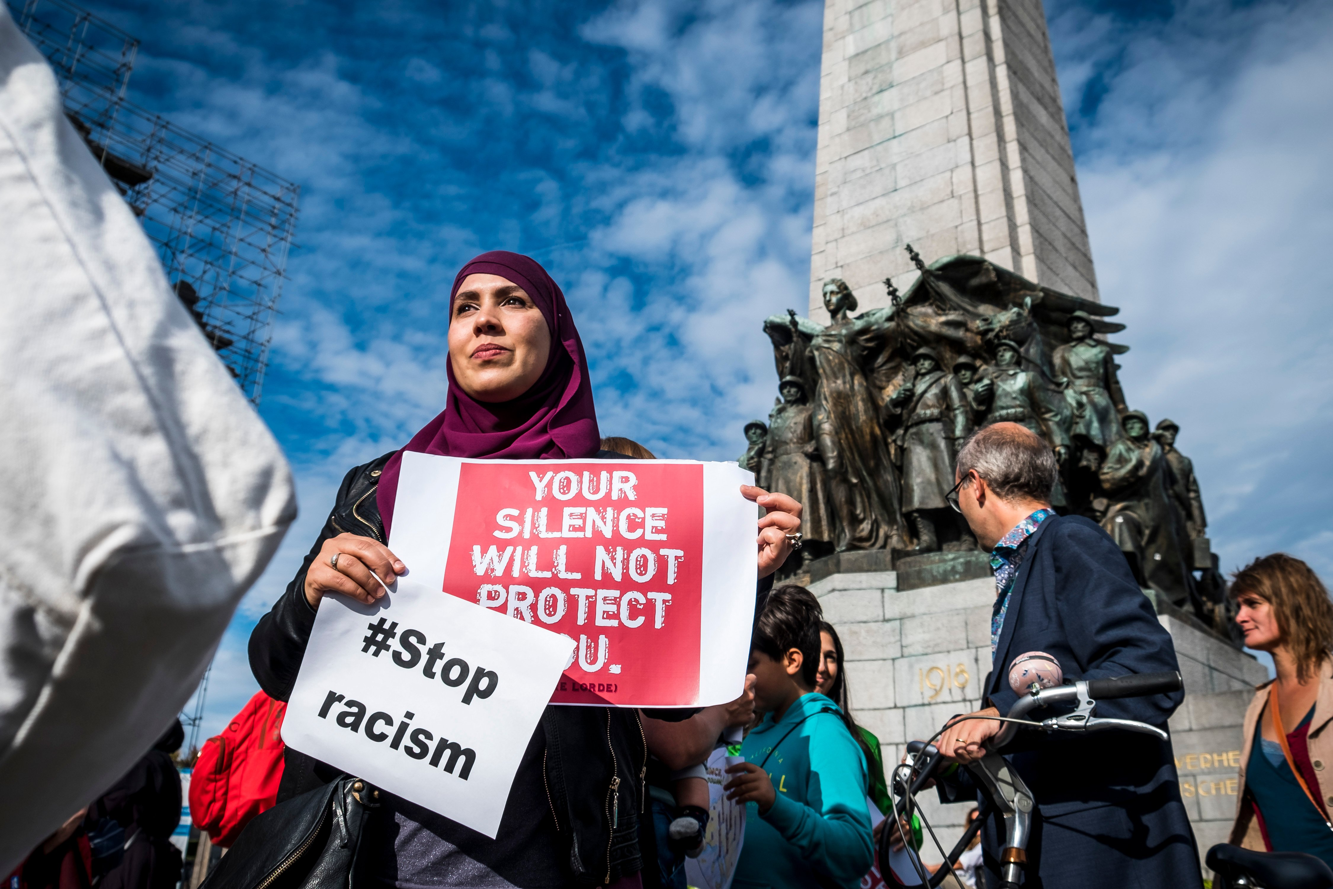 People hold posters as they protest against 'hate and islamophobia' in Brussels (AFP)