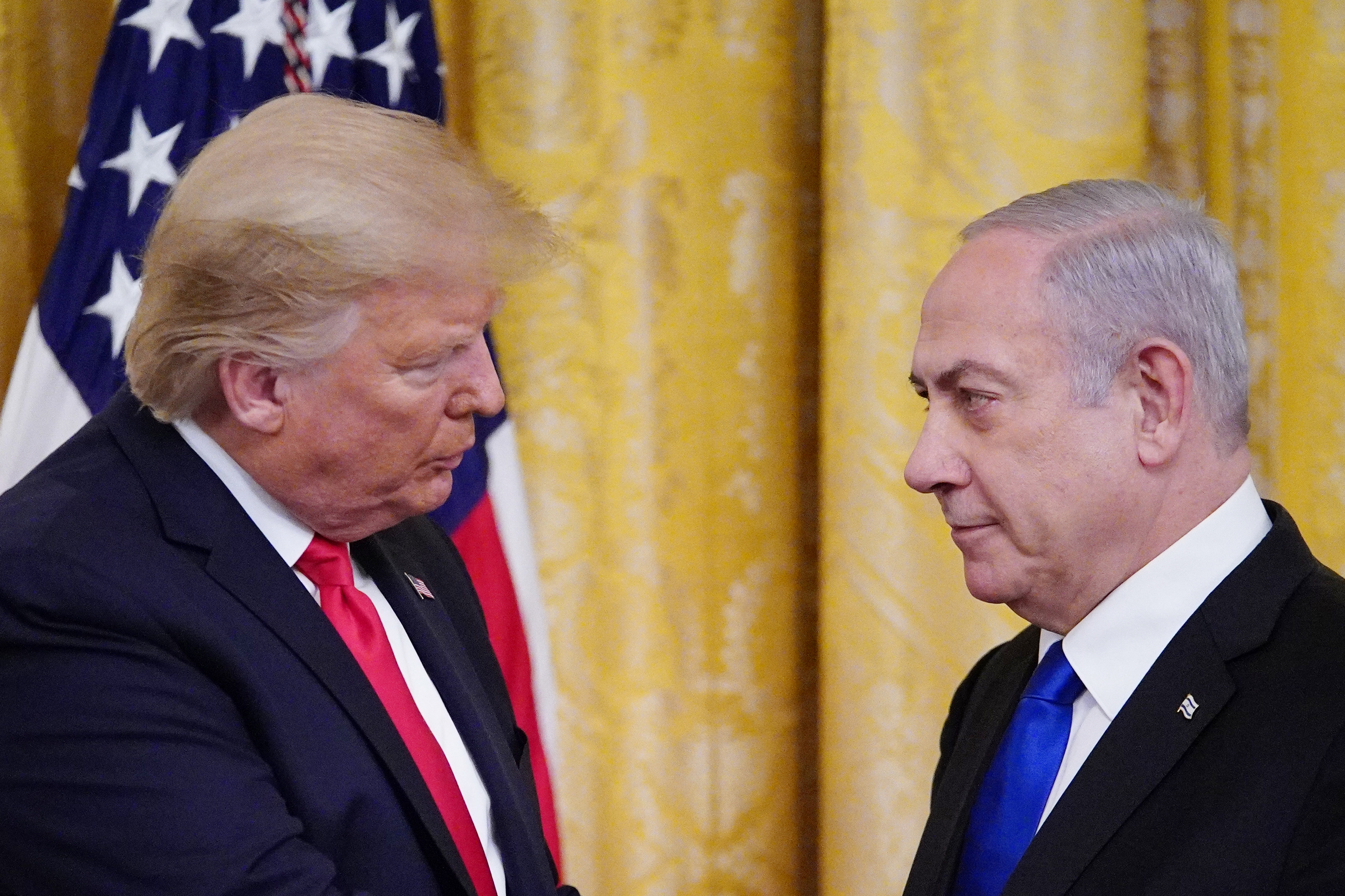 US President Donald Trump and Israel's Prime Minister Benjamin Netanyahu in the East Room of the White House in Washington, DC on 28 January (AFP)