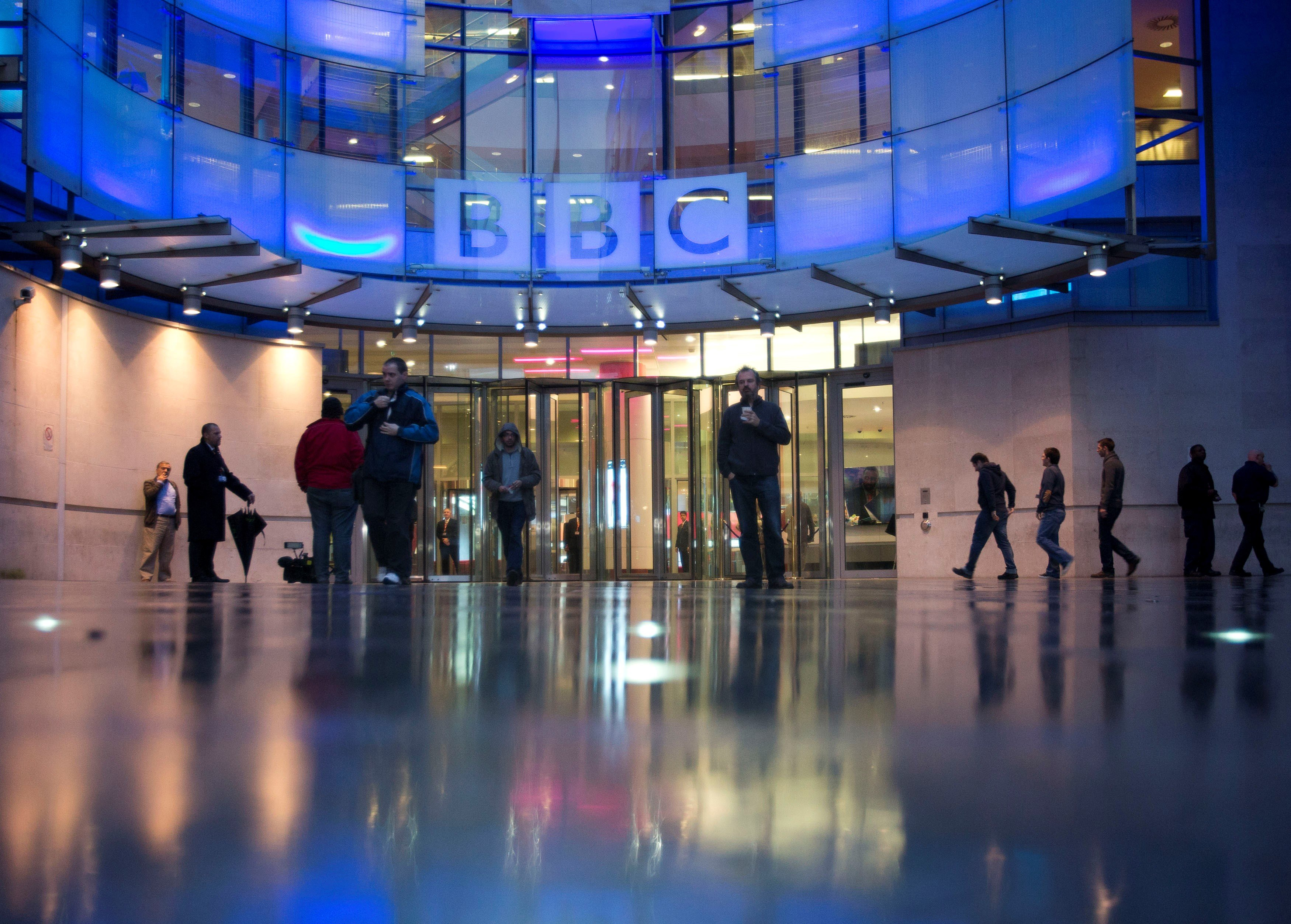 People arrive at, and leave, the BBC headquarters (Reuters)