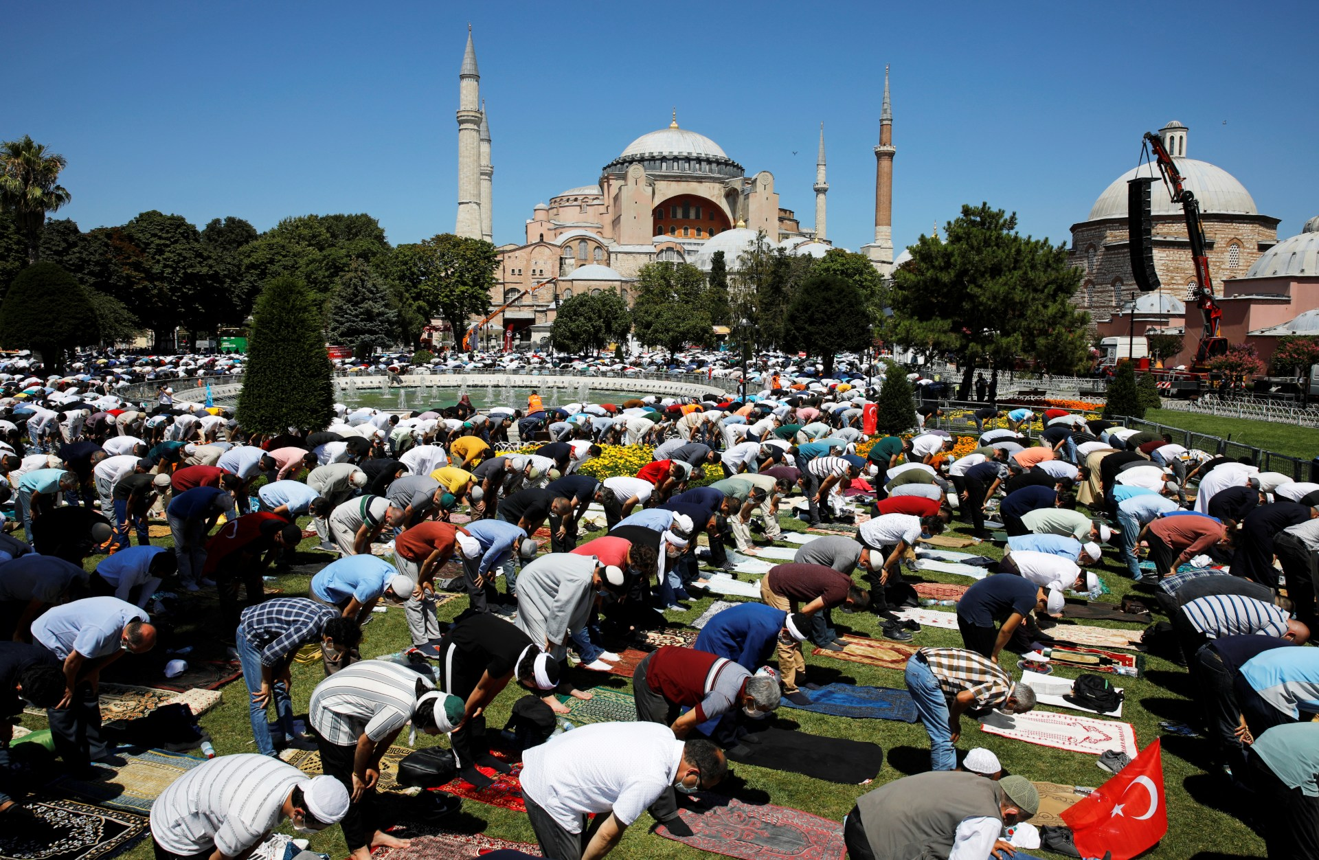 Muslims attend Friday prayers outside Hagia Sophia Grand Mosque, for the first time after it was once again declared a mosque after 86 years, in Istanbul (Reuters)