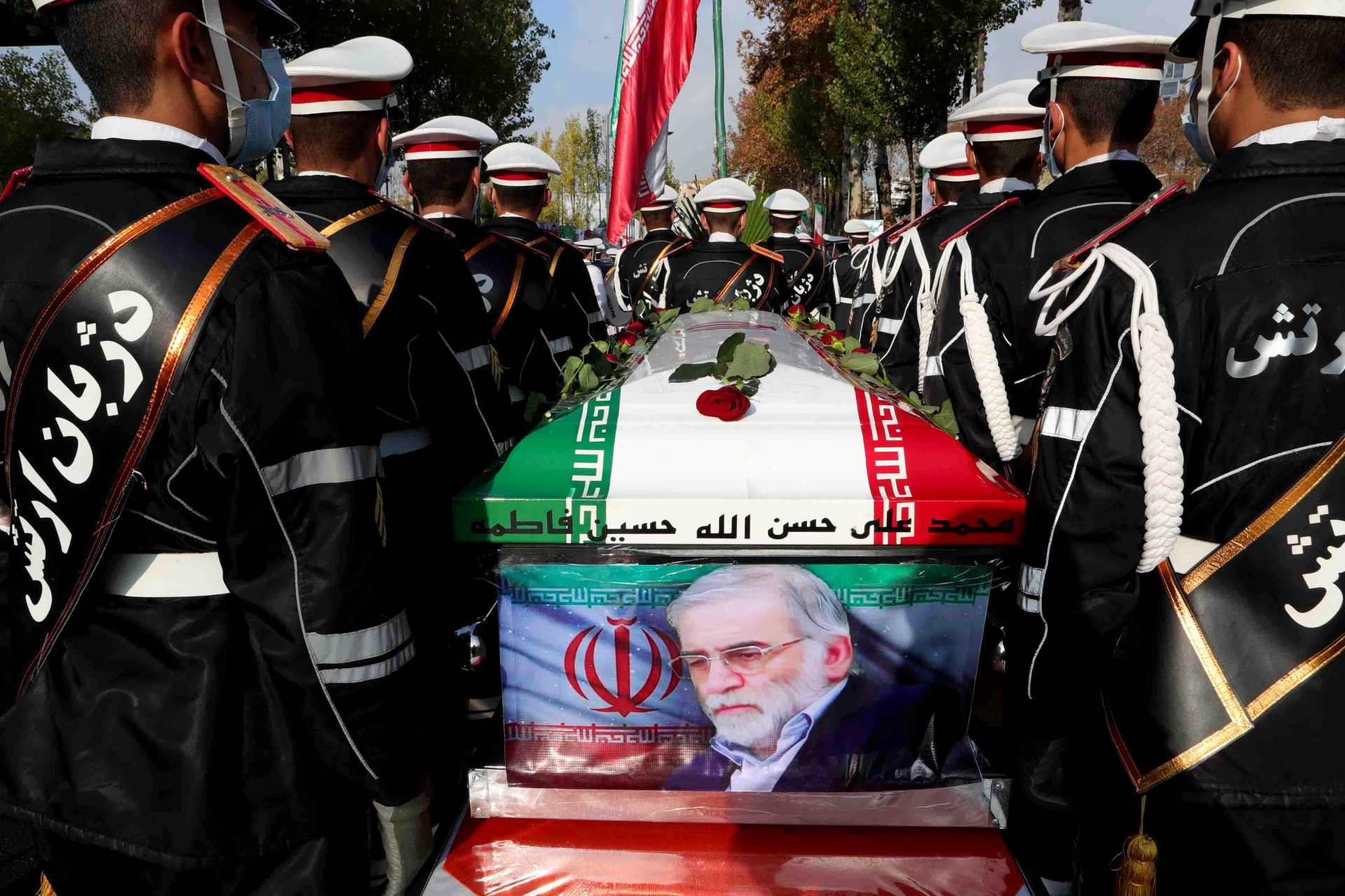 Iranian forces carry the coffin of nuclear scientist Mohsen Fakhrizadeh in Tehran (Reuters)